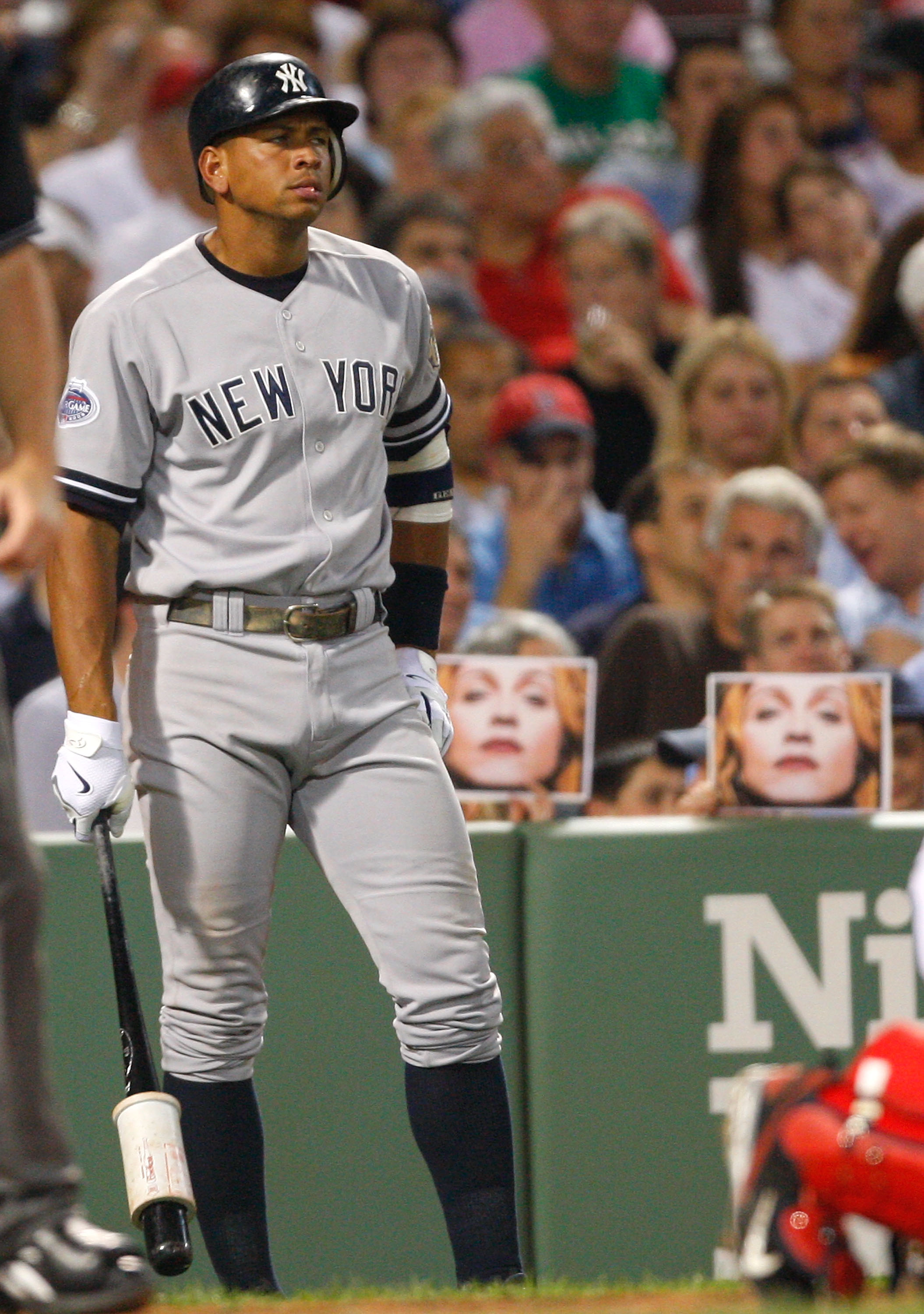 BOSTON - JULY 25: Fans hold pictures of Madonna as Alex Rodriguez #13 of the New York Yankees prepares to bat against the Boston Red Sox at Fenway Park on July 25, 2008 in Boston, Massachusetts.  (Photo by Jim Rogash/Getty Images)