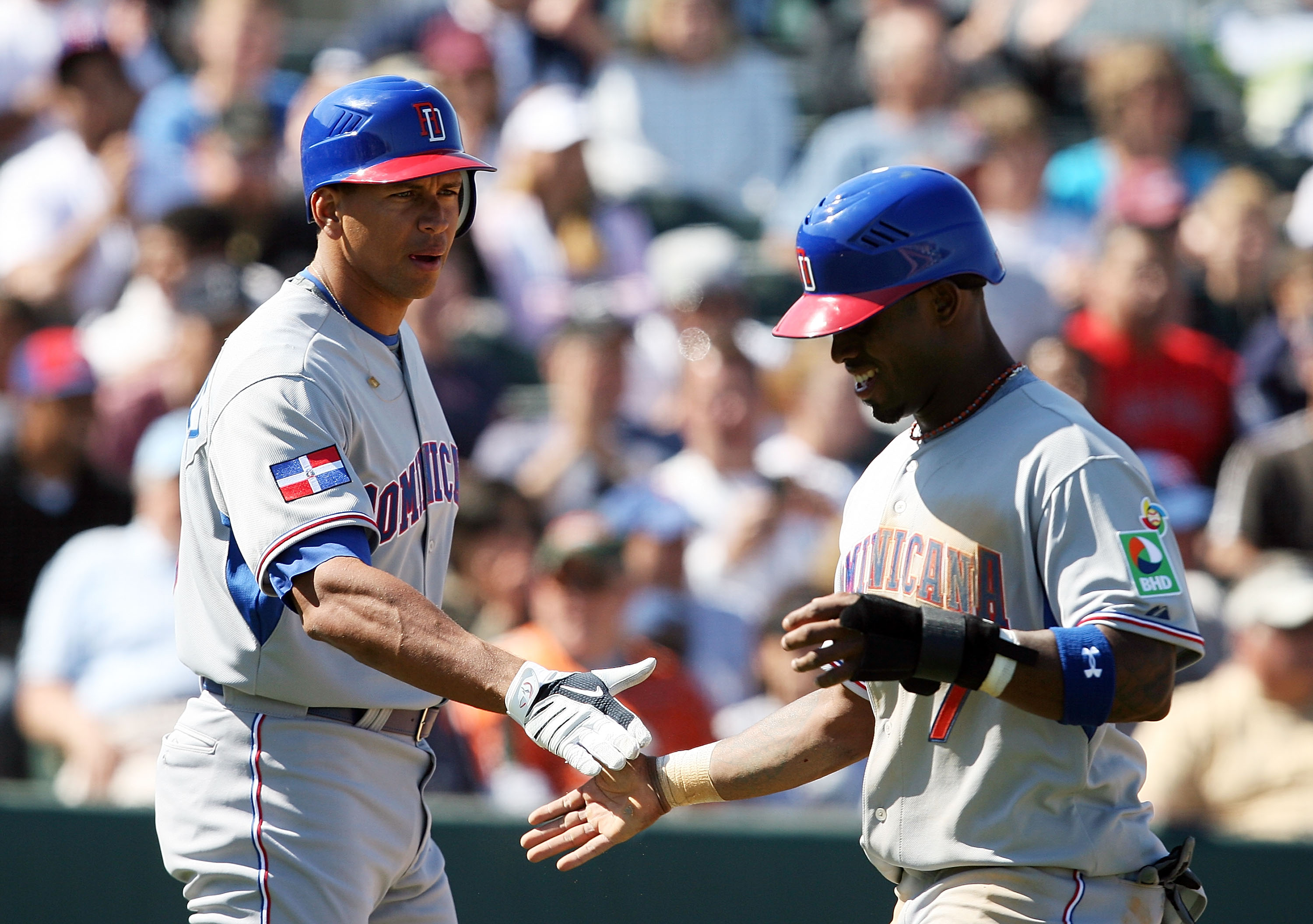 JUPITER, FL - MARCH 3:  Alex Rodriguez #13 of the Dominican Republic congratulates Jose Reyes #7 after Reyes scored against the Florida Marlins during an exhibition game at Roger Dean Stadium March 3, 2009 in Jupiter, Florida.  (Photo by Doug Benc/Getty I