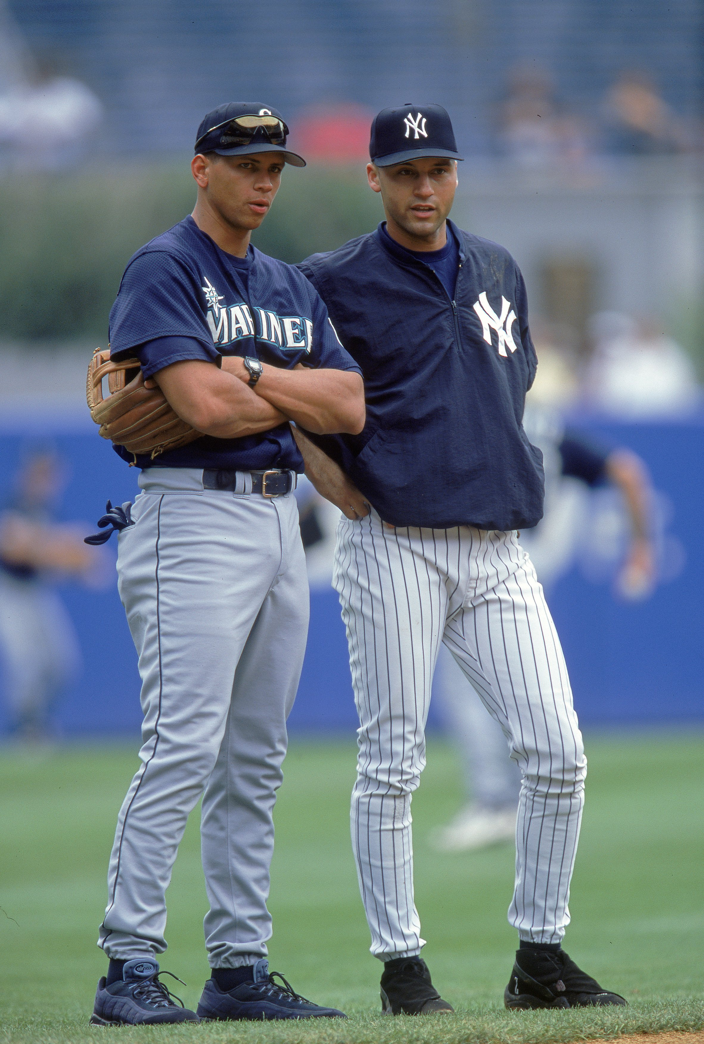 6 Aug 2000:  Derek Jeter #2 of the New York Yankees talks with Alex Rodriguez #3 of the Seattle Mariners during practice before the game at Yankee Stadium in the Bronx, New York. The Mariners defeated the Yankees 11-1.Mandatory Credit: Jamie Squire  /Alls