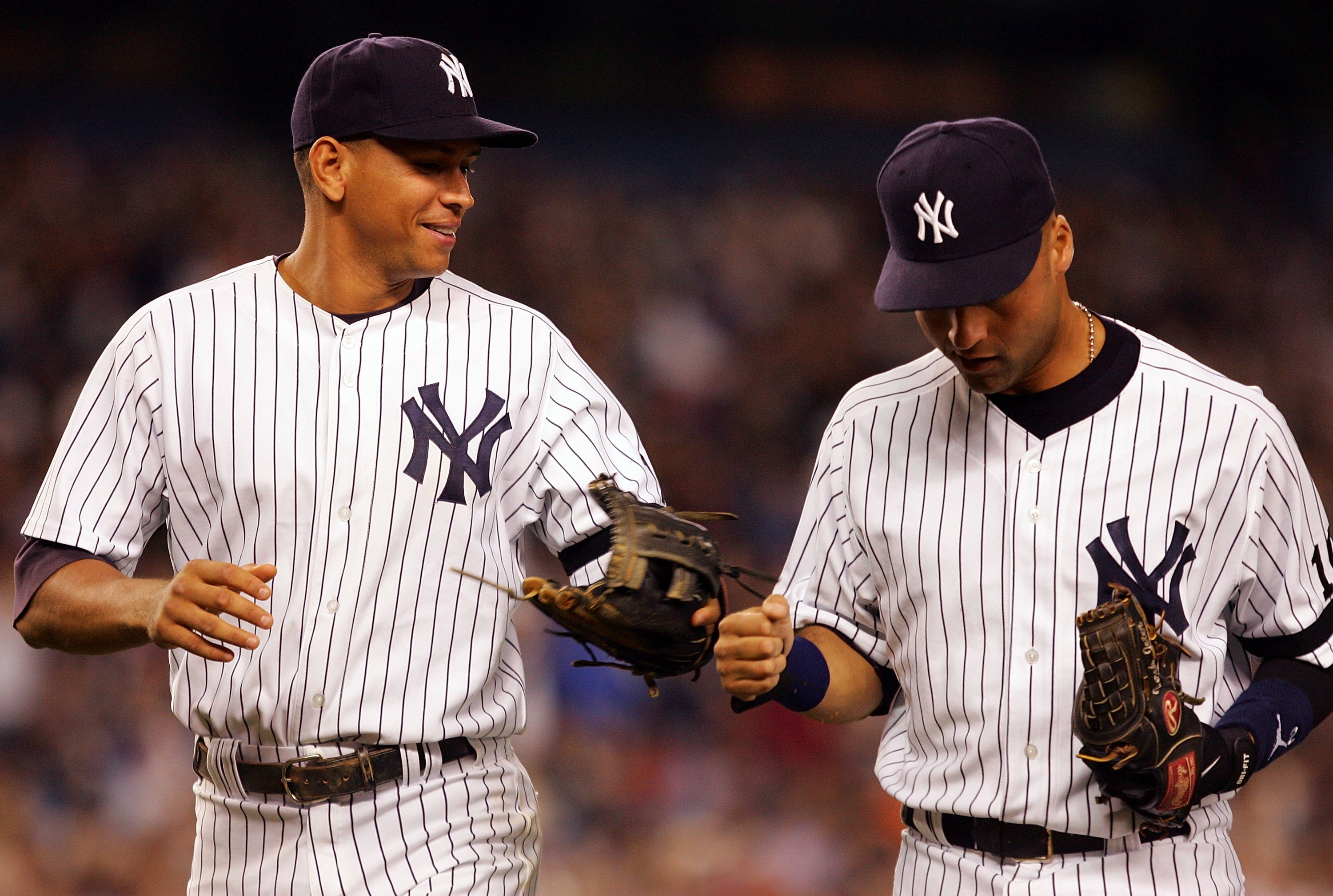 NEW YORK - SEPTEMBER 19: Alex Rodriguez #13 (L) and Derek Jeter #2 of the New York Yankees celebrate an inning double play against the Baltimore Orioles during their game at Yankee Stadium on September 19, 2007 in the Bronx borough of New York City.  (Pho