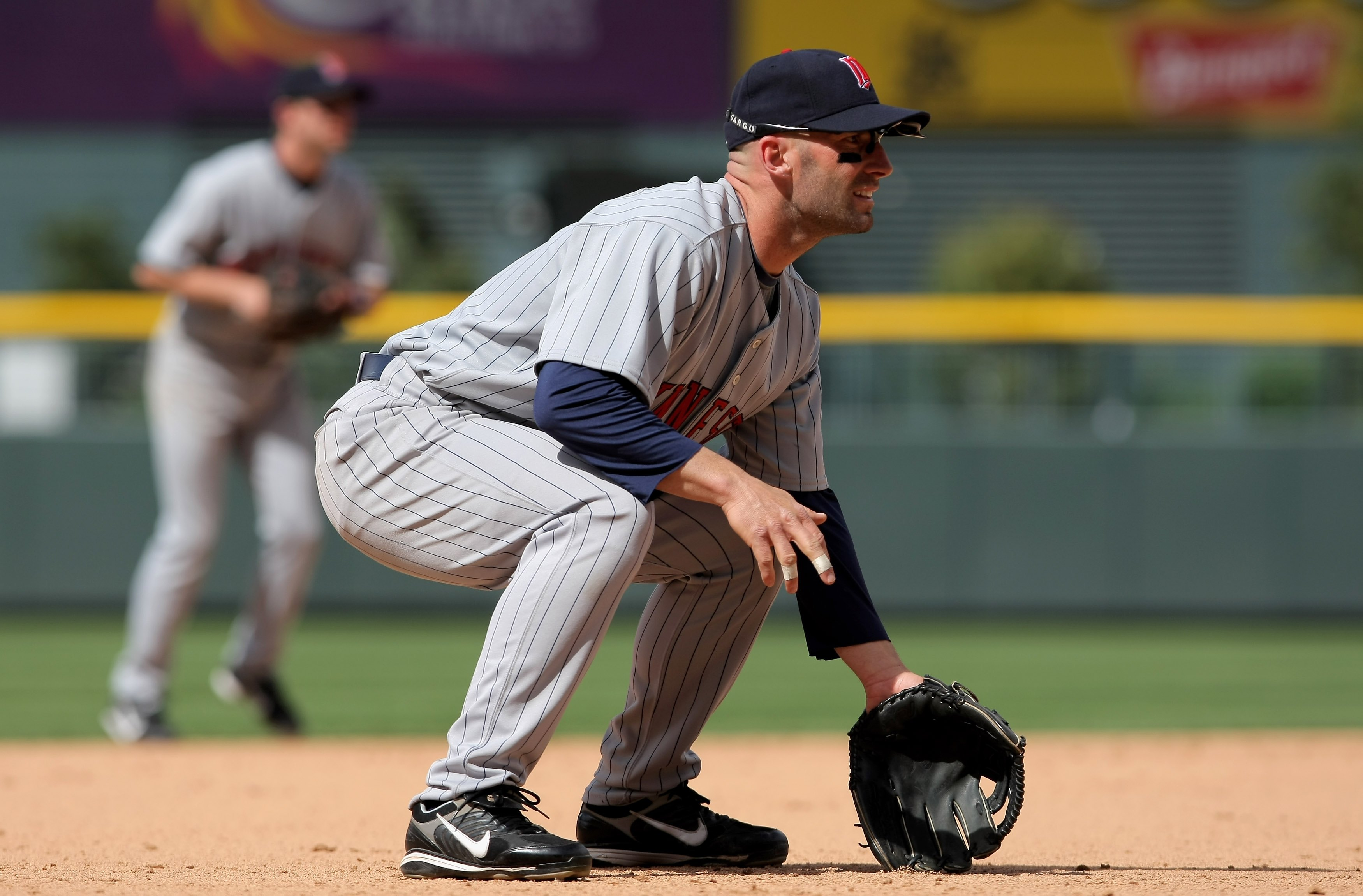 DENVER - MAY 18:  Third baseman Howie Clark #19 of the Minnesota Twins plays defense against the Colorado Rockies during Interleague MLB action at Coors Field on May 18, 2008 in Denver, Colorado. The Rockies defeated the Twins 6-2.  (Photo by Doug Pensing