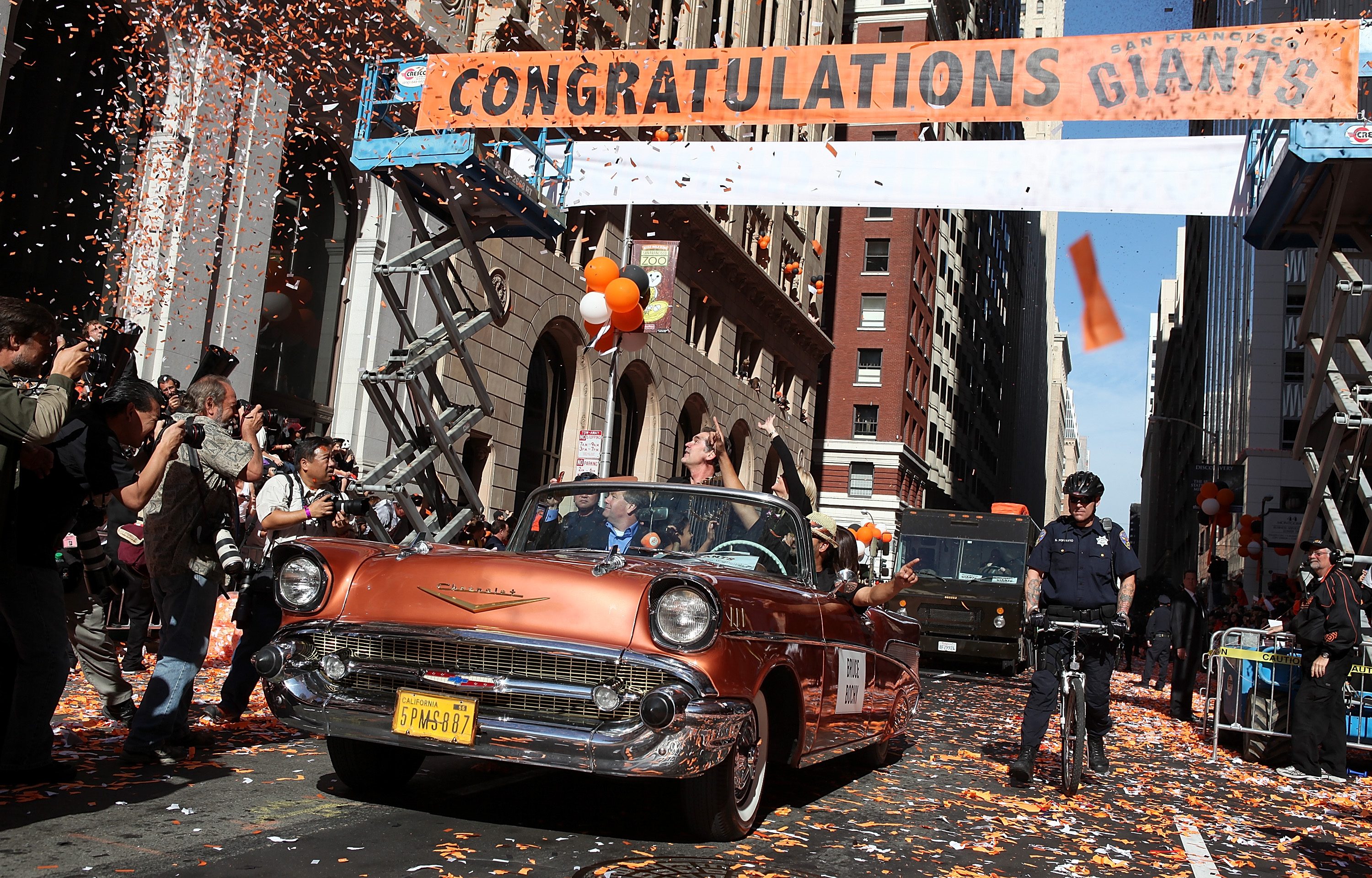 SAN FRANCISCO - NOVEMBER 03:  San Francisco Giants manager Bruce Bochy rides in a vintage car during the Giants' vicotry parade on November 3, 2010 in San Francisco, California. Thousands of Giants fans lined the streets of San Francisco to watch the San