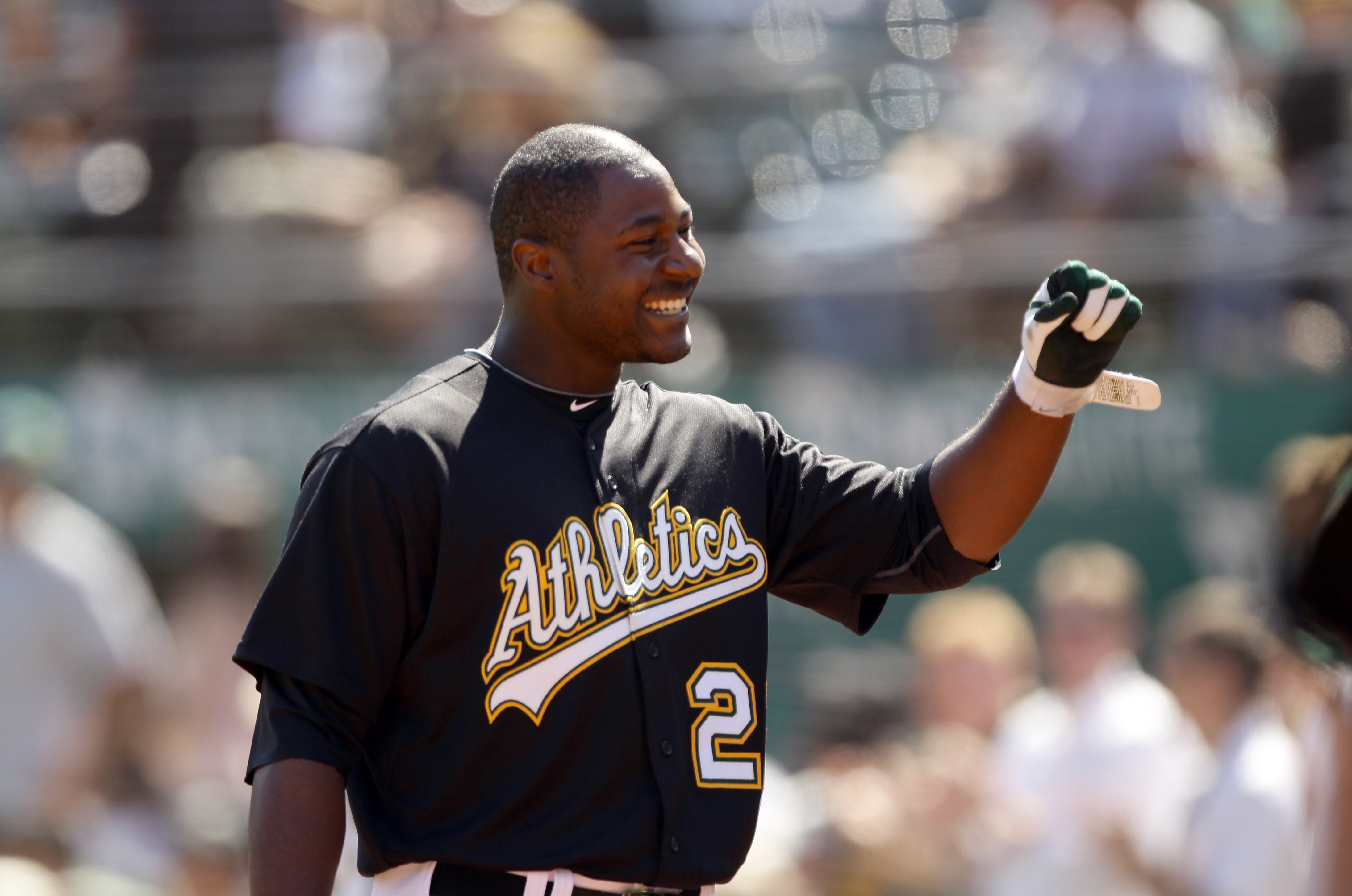 OAKLAND, CA - SEPTEMBER 22:  Chris Carter #22 of the Oakland Athletics smiles as he walks back to the dugout after hitting his first major league home run against the Chicago White Sox at the Oakland-Alameda County Coliseum on September 22, 2010 in Oaklan