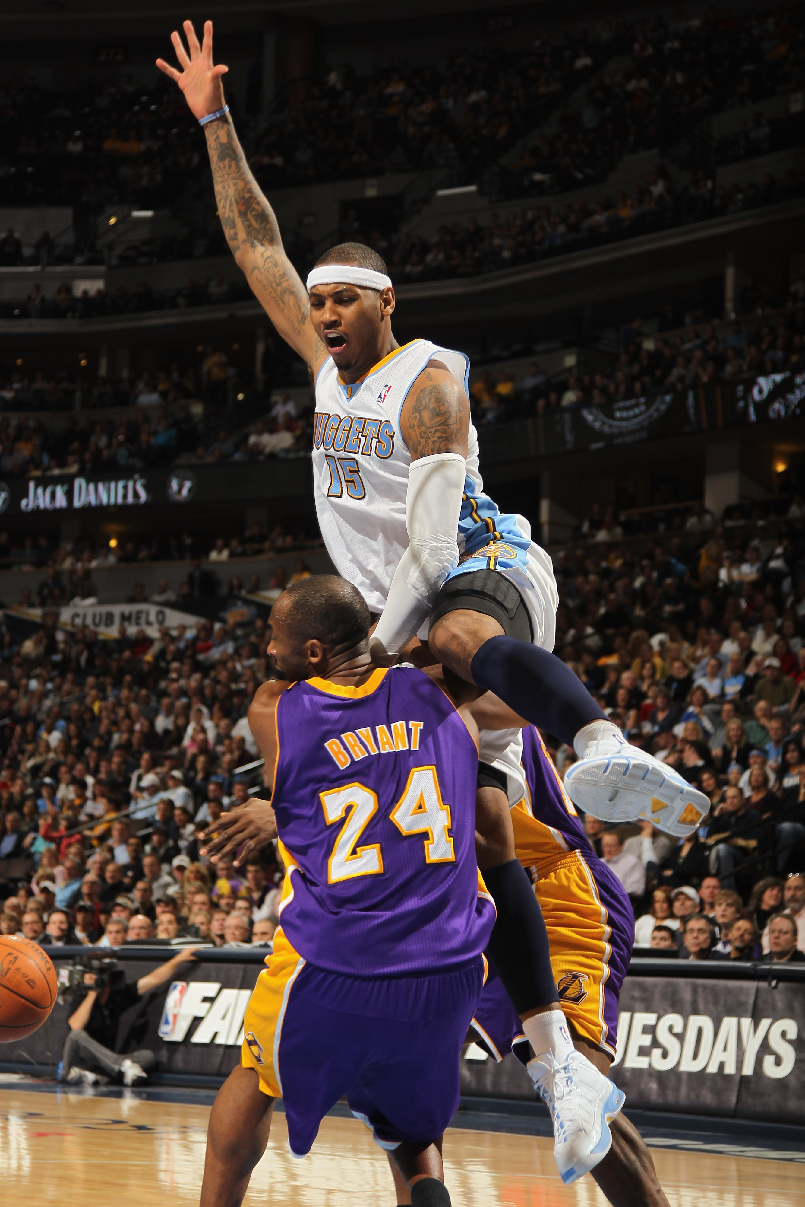 DENVER, CO - JANUARY 21:  Carmelo Anthony #15 of the Denver Nuggets collides with Kobe Bryant #24 of the Los Angeles Lakers at the Pepsi Center on January 21, 2011 in Denver, Colorado. The Lakers defeated the Nuggets 107-97. NOTE TO USER: User expressly a