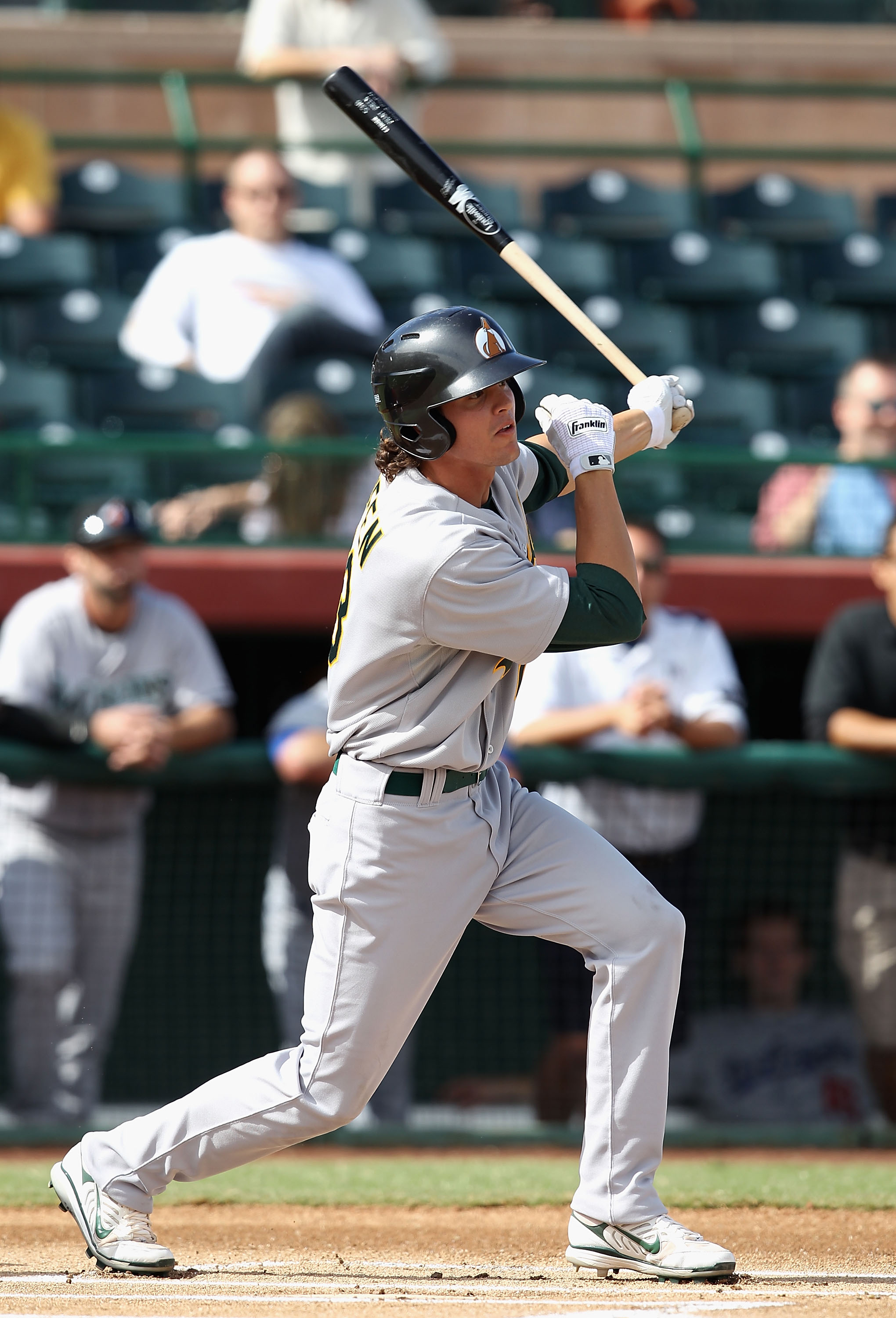 SCOTTSDALE, AZ - OCTOBER 23:  Oakland Athletics prospect Grant Green playing for the Phoenix Desert Dogs hits a single against the Scottsdale Scorpions during the AZ Fall League game at Scottsdale Stadium on October 23, 2010 in Scottsdale, Arizona.  (Phot