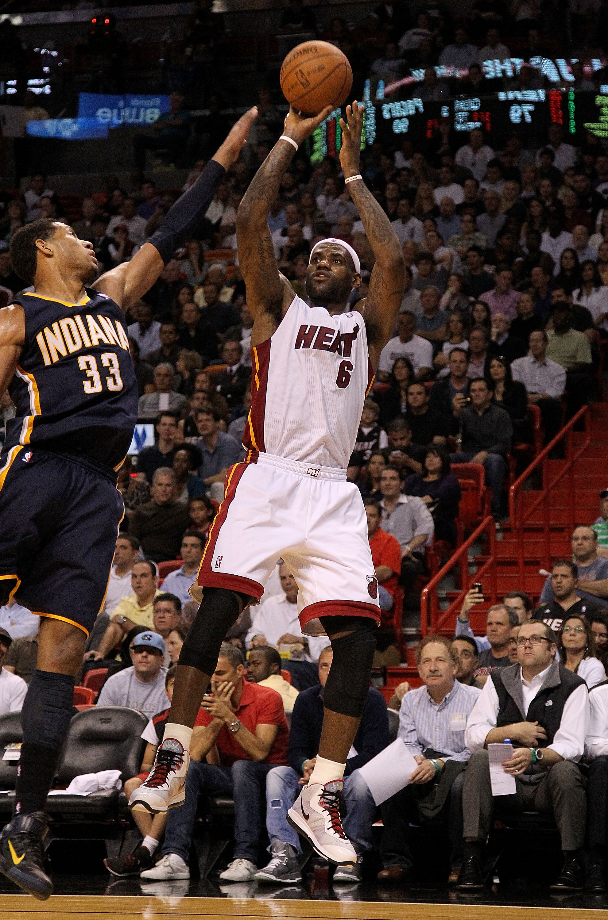 MIAMI, FL - FEBRUARY 08:  LeBron James #6 of the Miami Heat shoots over Danny Granger #33 of the Indiana Pacers during a game at American Airlines Arena on February 8, 2011 in Miami, Florida. NOTE TO USER: User expressly acknowledges and agrees that, by d