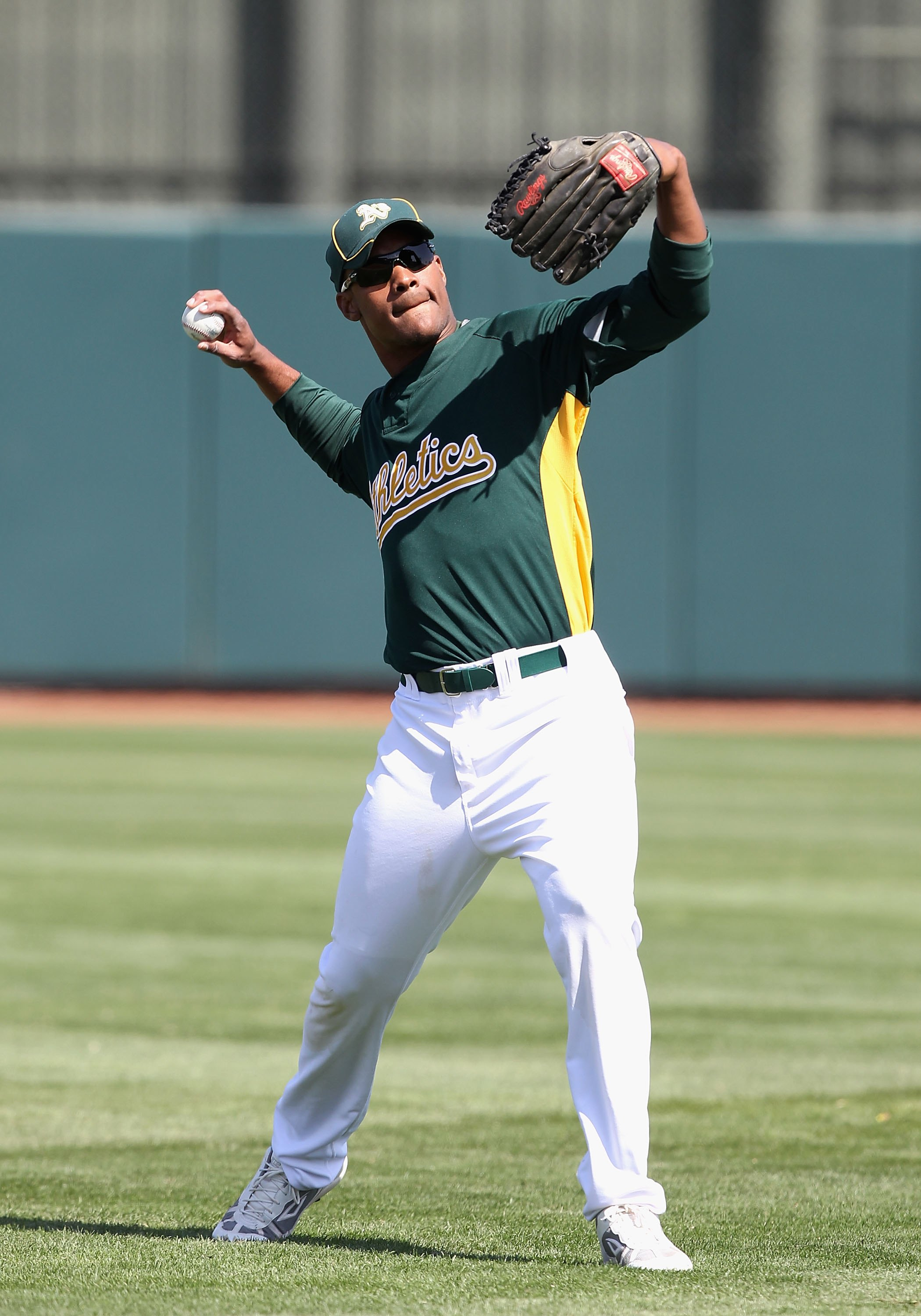 PHOENIX - MARCH 10:  Michael Taylor #23 of the Oakland Athletics warms up before the MLB spring training game against the Chicago White Sox at Phoenix Municipal Stadium on March 10, 2010 in Phoenix, Arizona. The White Sox defeated the A's 9-5  (Photo by C