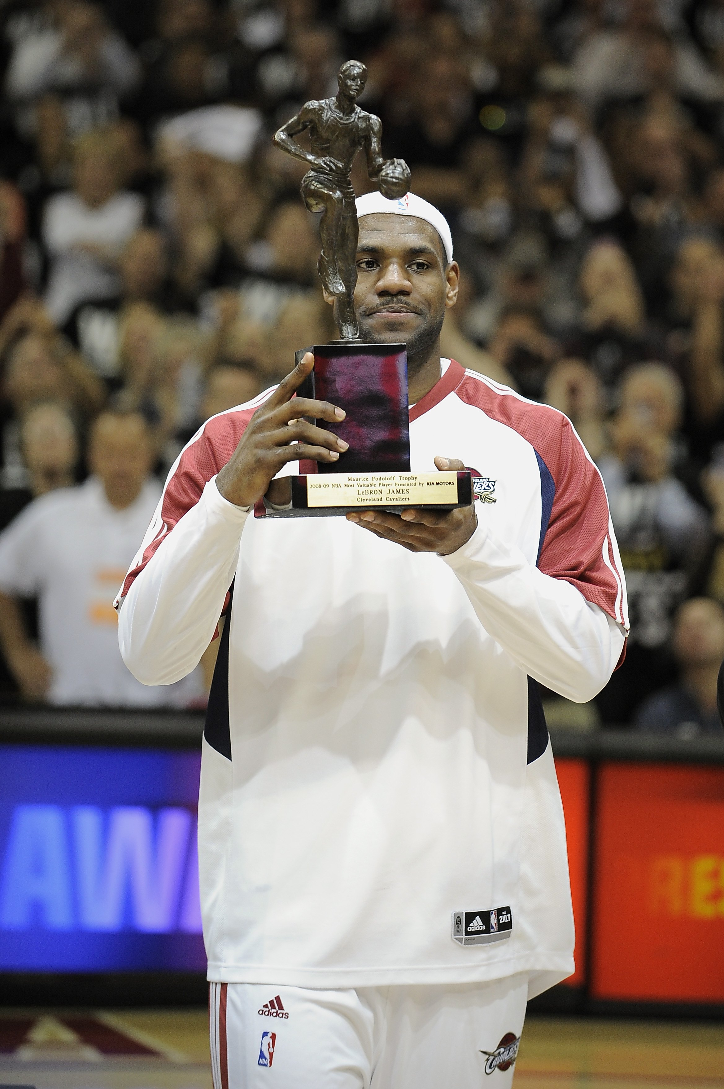CLEVELAND - MAY 5:  LeBron James #23 of the Cleveland Cavaliers receives the 2008-2009 MVP Trophy prior to the start of Game One of the Eastern Conference Semifinals against the Atlanta Hawks during the 2009 NBA Playoffs at Quicken Loans Arena on May 5, 2