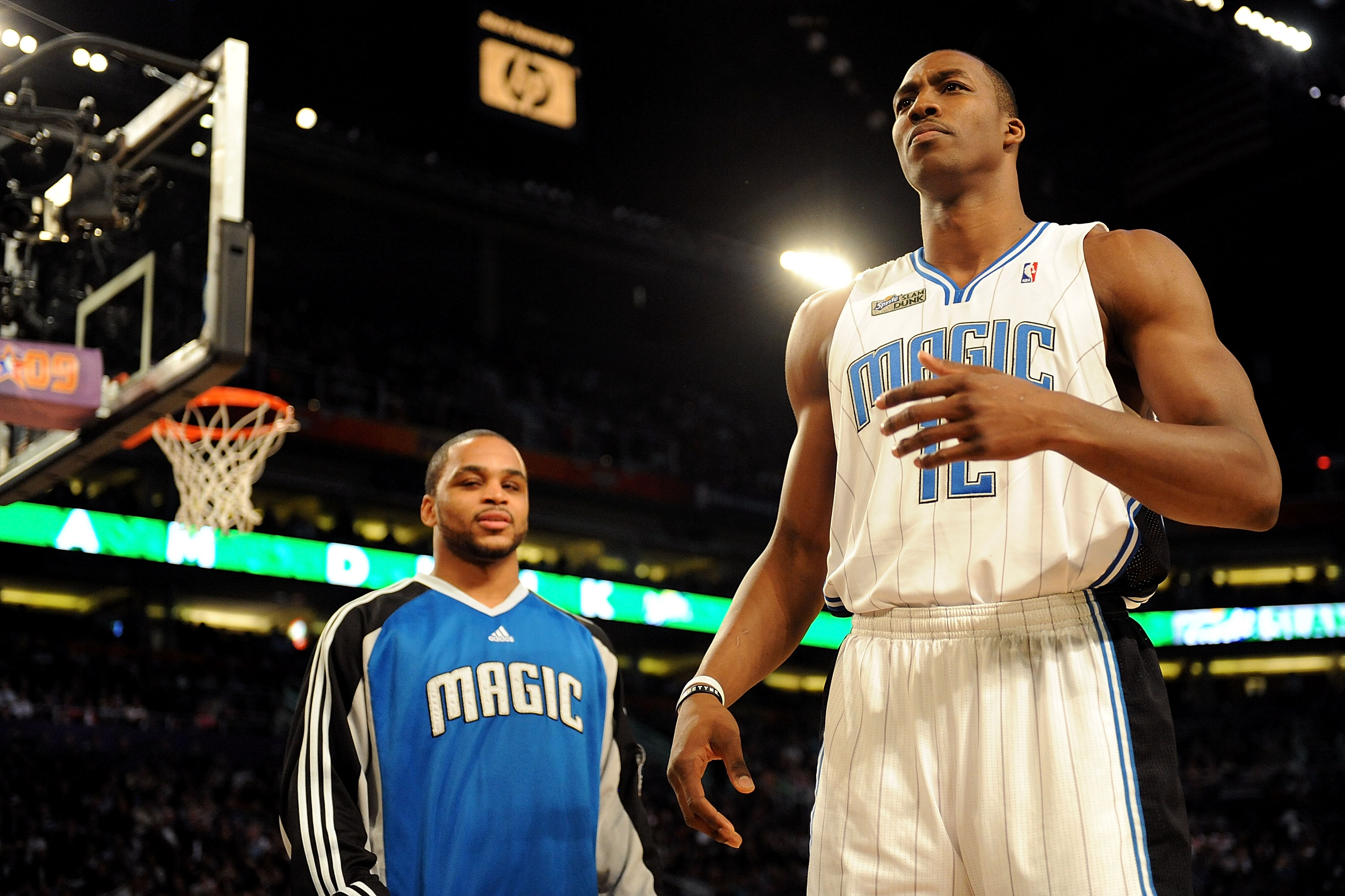 PHOENIX - FEBRUARY 14:  Jameer Nelson helps out teammate Dwight Howard of the Orlando Magic in the Sprite Slam Dunk Contest on All-Star Saturday Night, part of 2009 NBA All-Star Weekend at US Airways Center on February 14, 2009 in Phoenix, Arizona.  NOTE