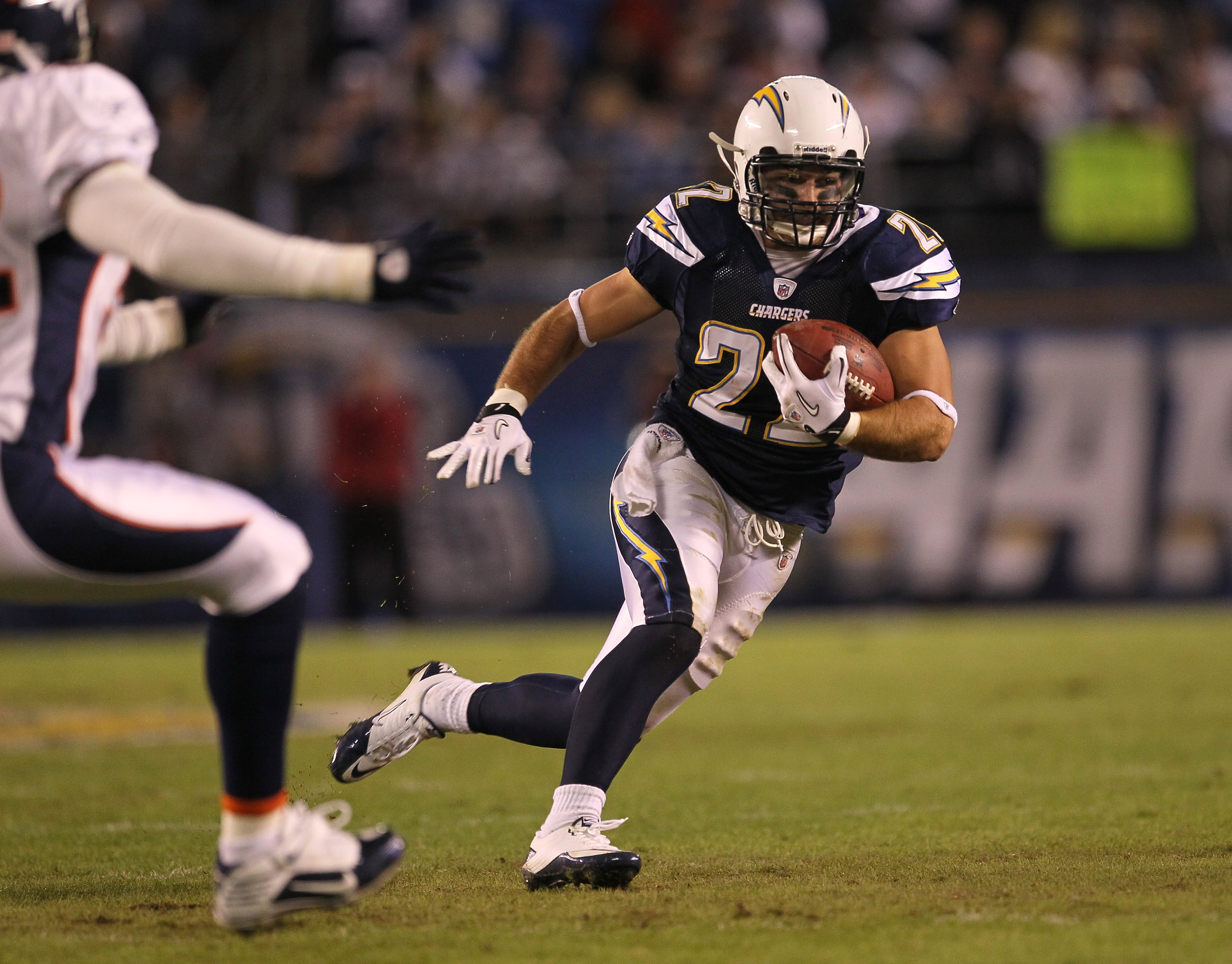 SAN DIEGO - NOVEMBER 22:  Running back Jacob Hester #22 of the San Diego Chargers carries the ball after catching a pass against the Denver Broncos at Qualcomm Stadium on November 22, 2010 in San Diego, California.  (Photo by Stephen Dunn/Getty Images)