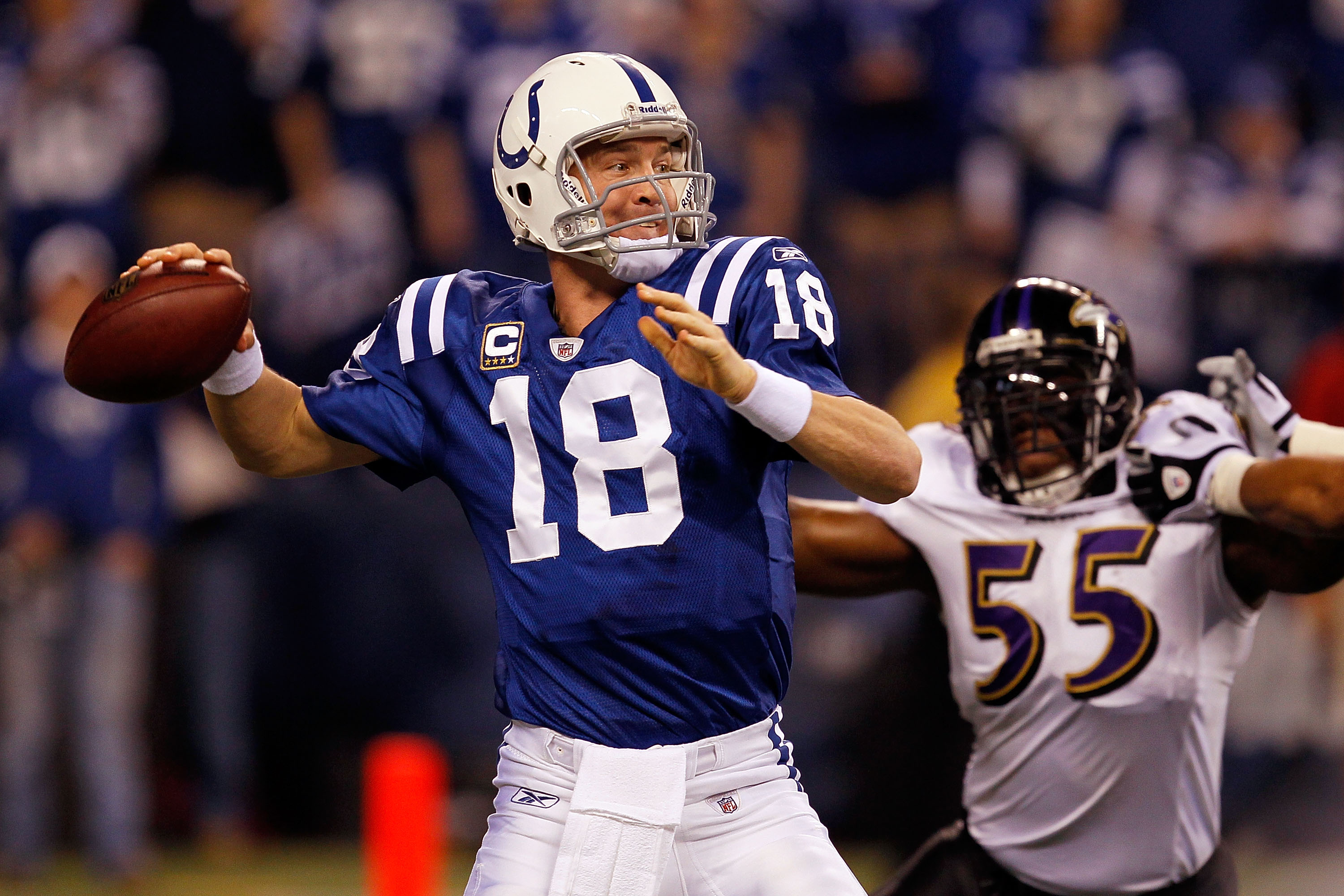 INDIANAPOLIS - JANUARY 16:  Quarterback Peyton Manning #18 of the Indianapolis Colts throws the ball as Terrell Suggs #55 of the Baltimore Ravens rushes in during the AFC Divisional Playoff Game at Lucas Oli Stadium on January 16, 2010 in Indianapolis, In