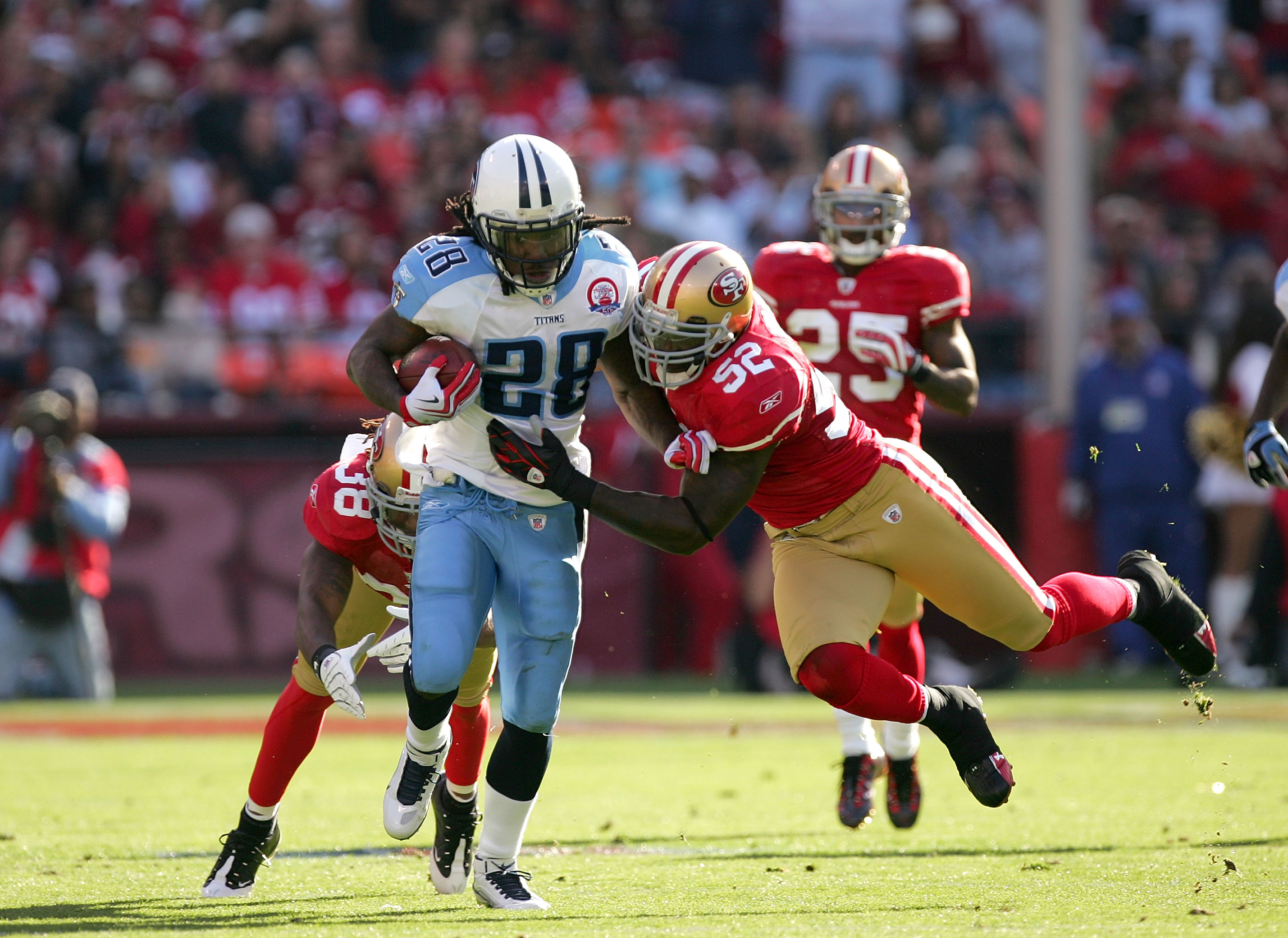 SAN FRANCISCO - NOVEMBER 08:  Chris Johnson #28 of the Tennessee Titans runs is tackled by Patrick Willis #52 of the San Francisco 49ers at Candlestick Park on November 8, 2009 in San Francisco, California.  (Photo by Ezra Shaw/Getty Images)