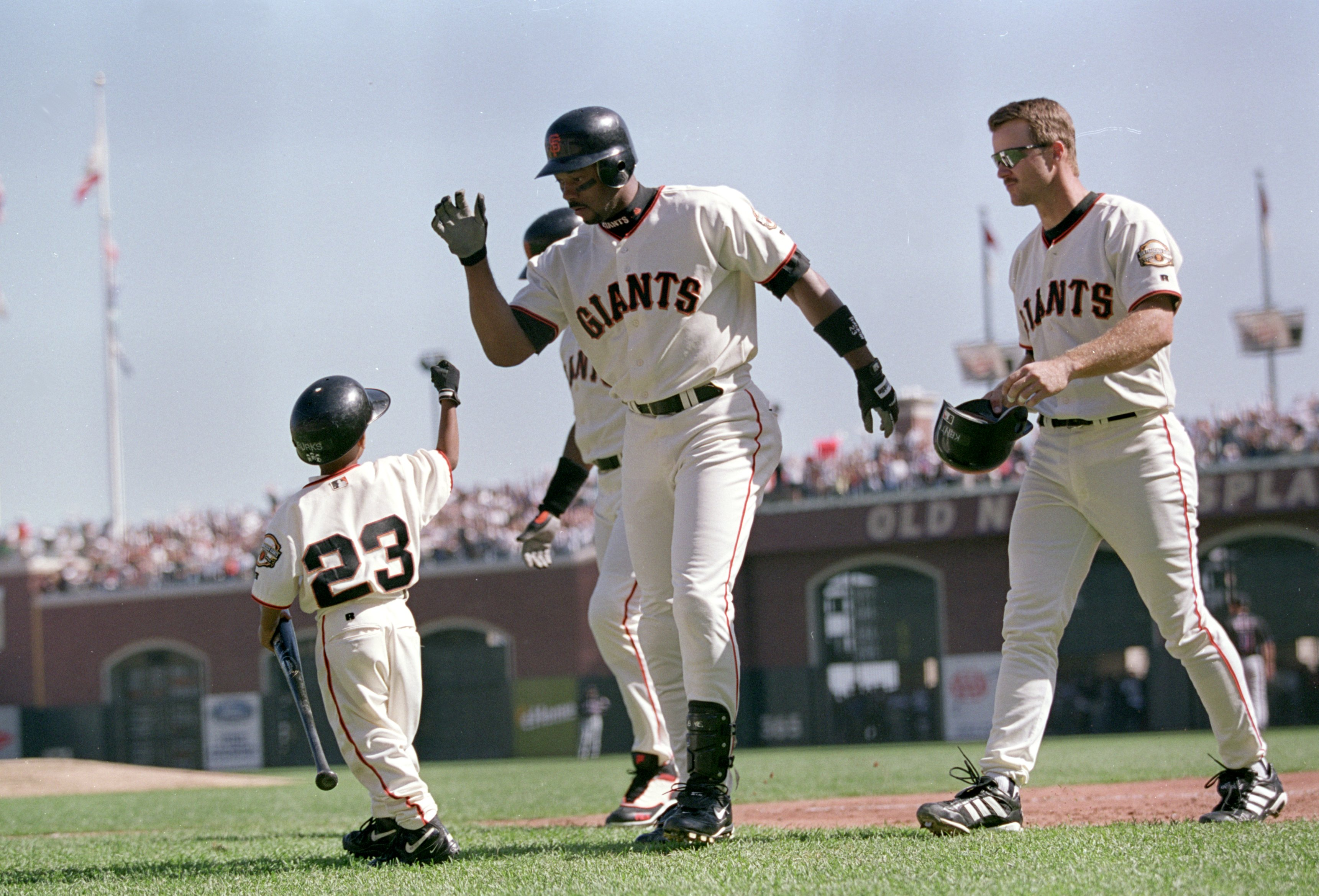 4 Oct 2000:  Ellis Burks #23 of the San Francisco Giants waves to a young fan during the NLDS Game against the New York Mets at Pac Bell Park in San Francisco, California. The Giants defeated the Mets 5-1.Mandatory Credit: Tom Hauck  /Allsport