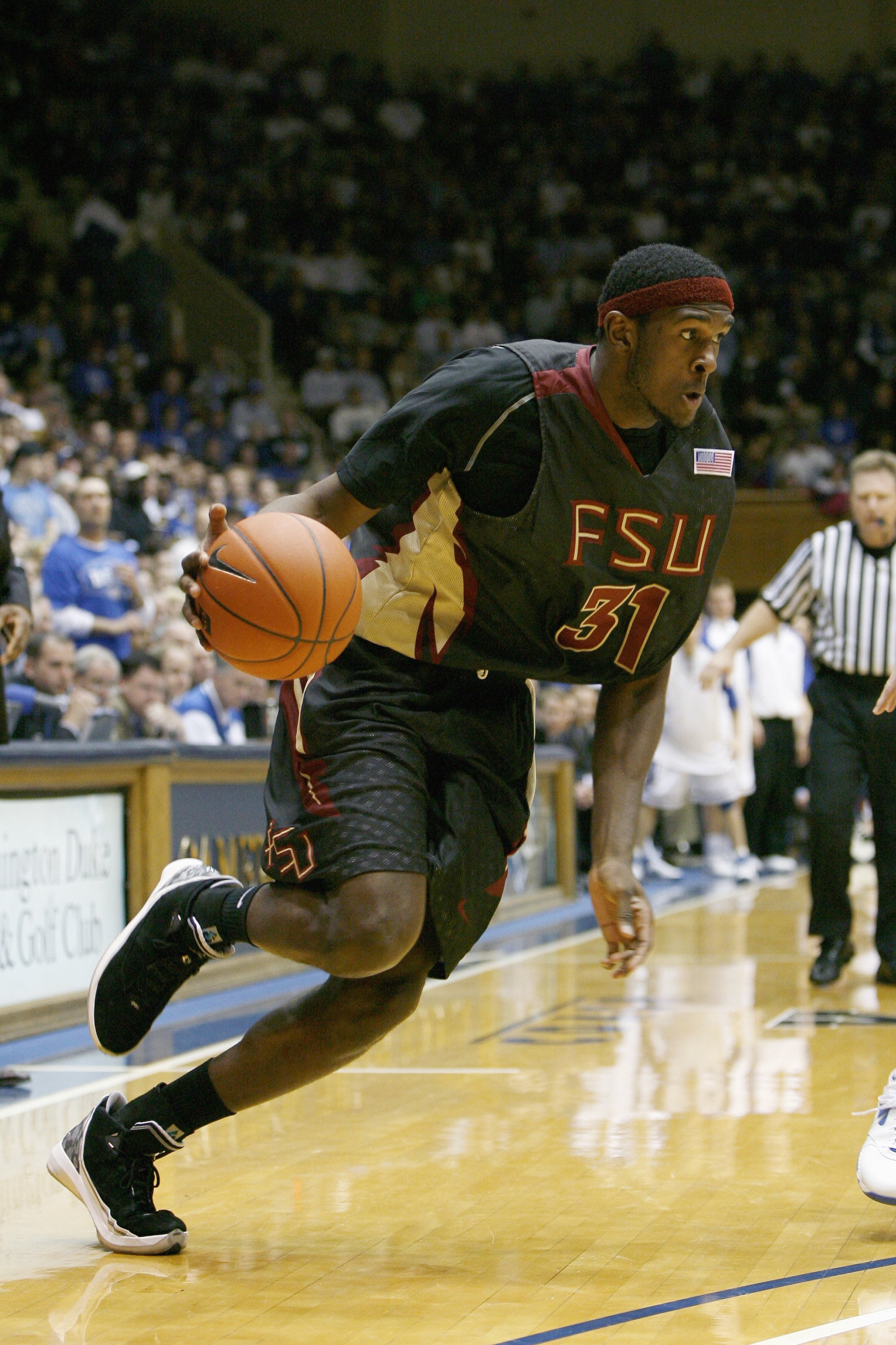 DURHAM, NC - MARCH 03: Chris Singleton #31 of the Florida State Seminoles dribbles the ball against the Duke Blue Devils during the game on March 3, 2009 at Cameron Indoor Stadium in Durham, North Carolina.  (Photo by Kevin C. Cox/Getty Images)