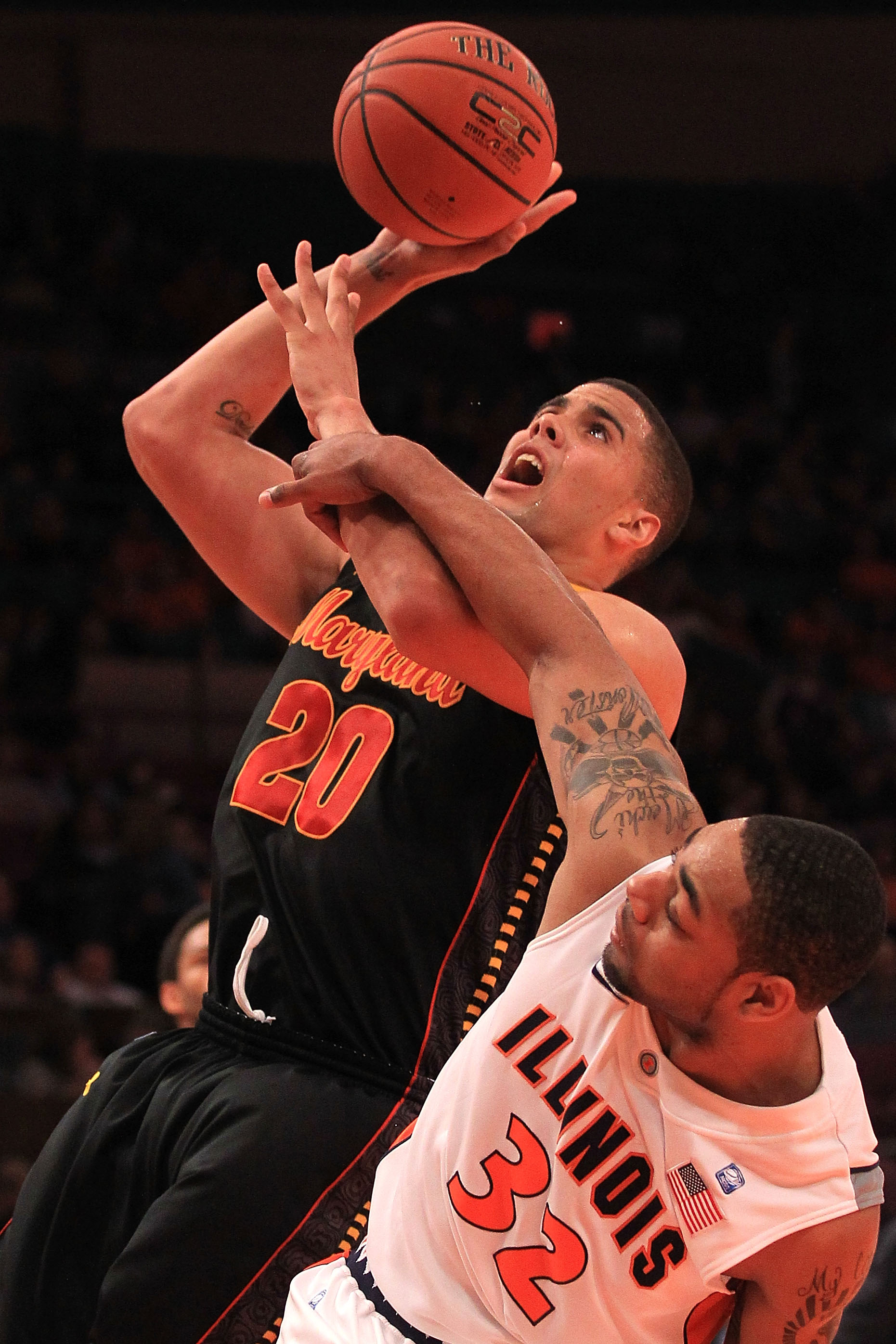NEW YORK - NOVEMBER 19:  Jordan Williams #20 of the Maryland Terrapins is fouled by Demetri McCamey #32 of the Illinois Fighting Illini during the 2k Sports Classic at Madison Square Garden on November 19, 2010 in New York, New York.  (Photo by Chris McGr