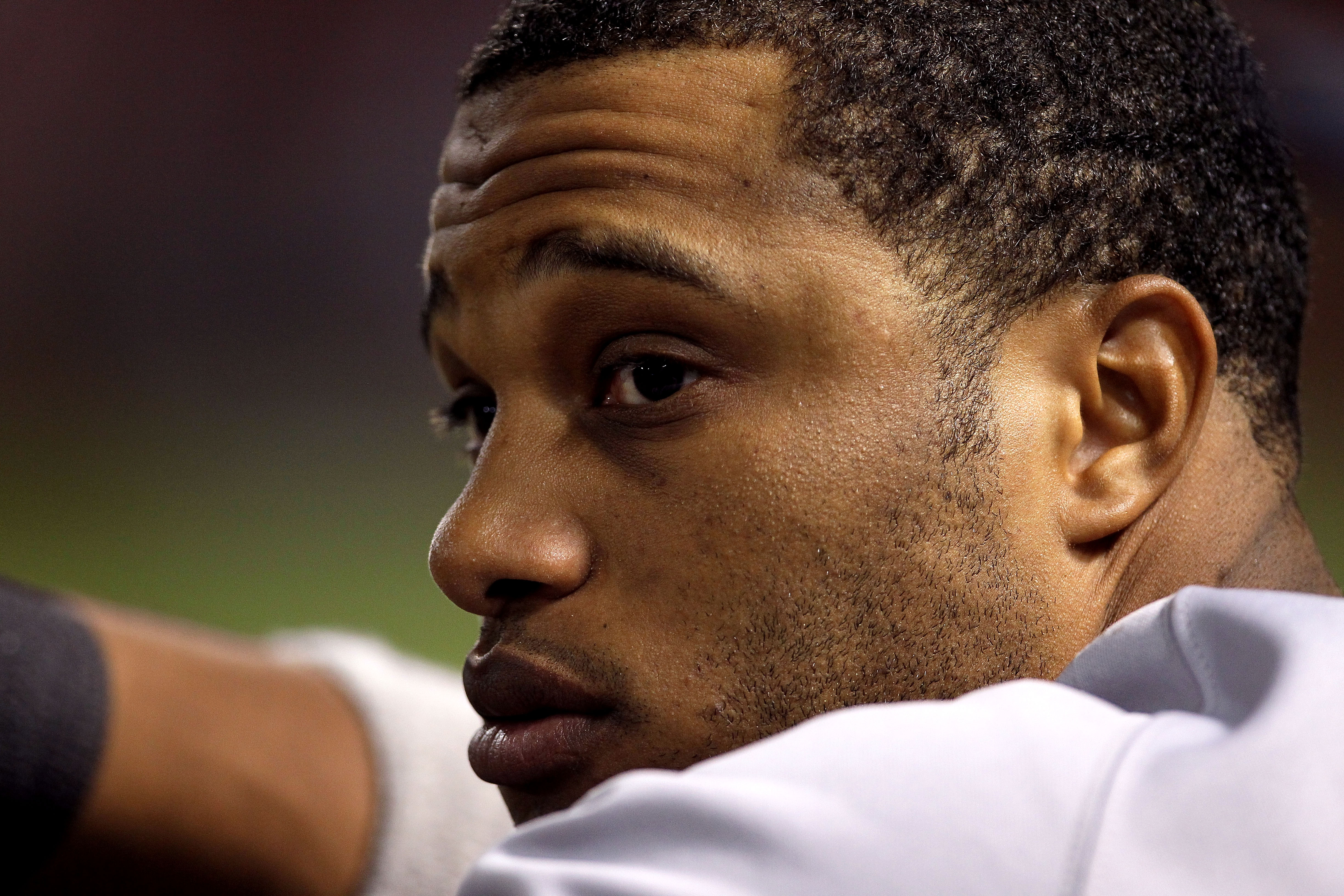 ARLINGTON, TX - OCTOBER 22:  Robinson Cano #24 of the New York Yankees looks on against the Texas Rangers in Game Six of the ALCS during the 2010 MLB Playoffs at Rangers Ballpark in Arlington on October 22, 2010 in Arlington, Texas.  (Photo by Stephen Dun