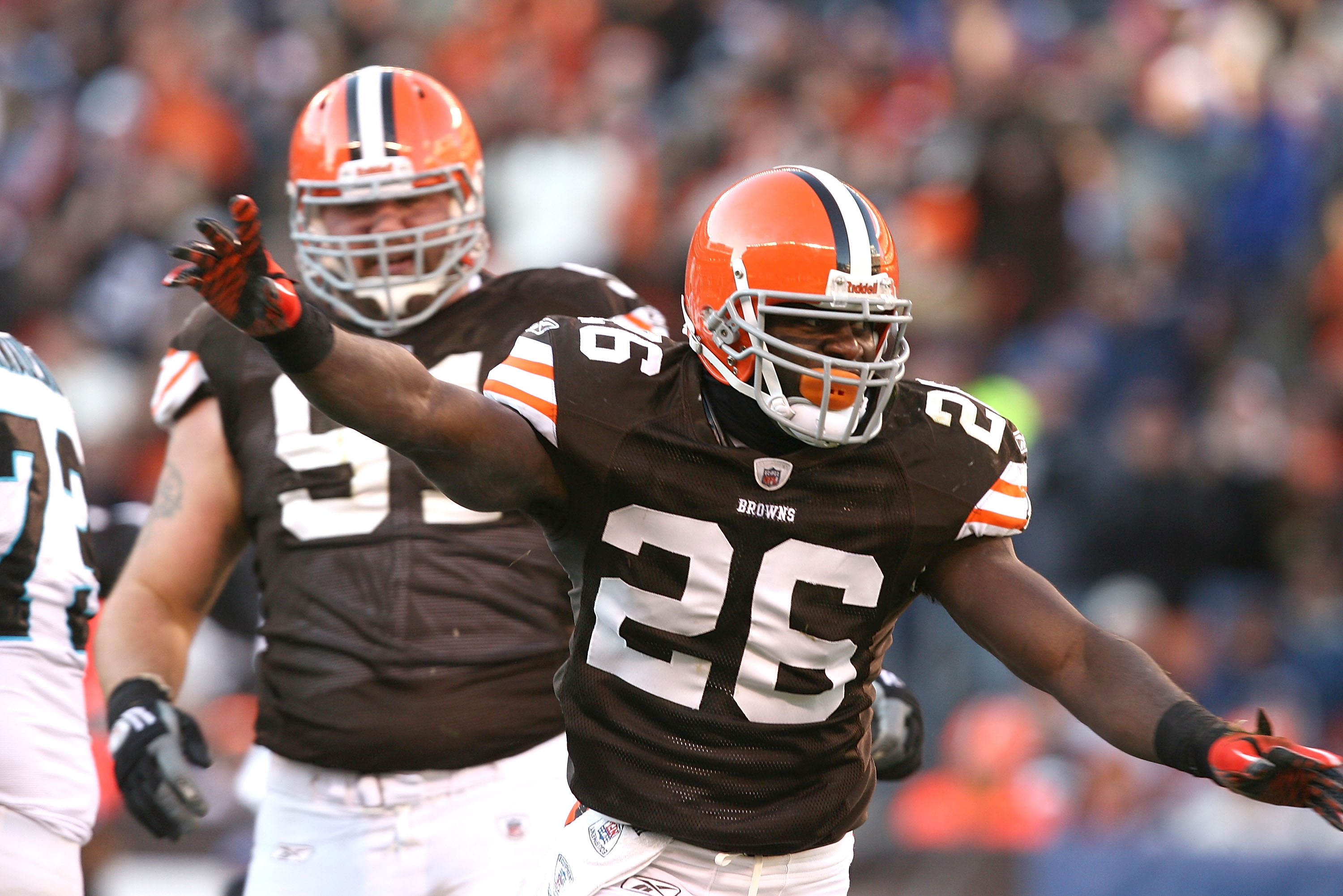 CLEVELAND - NOVEMBER 28:  Defensive players Abram Elam #26 and Brian Schaefering #91 of the Cleveland Browns celebrate after their game against the Carolina Panthers at Cleveland Browns Stadium on November 28, 2010 in Cleveland, Ohio.  (Photo by Matt Sull