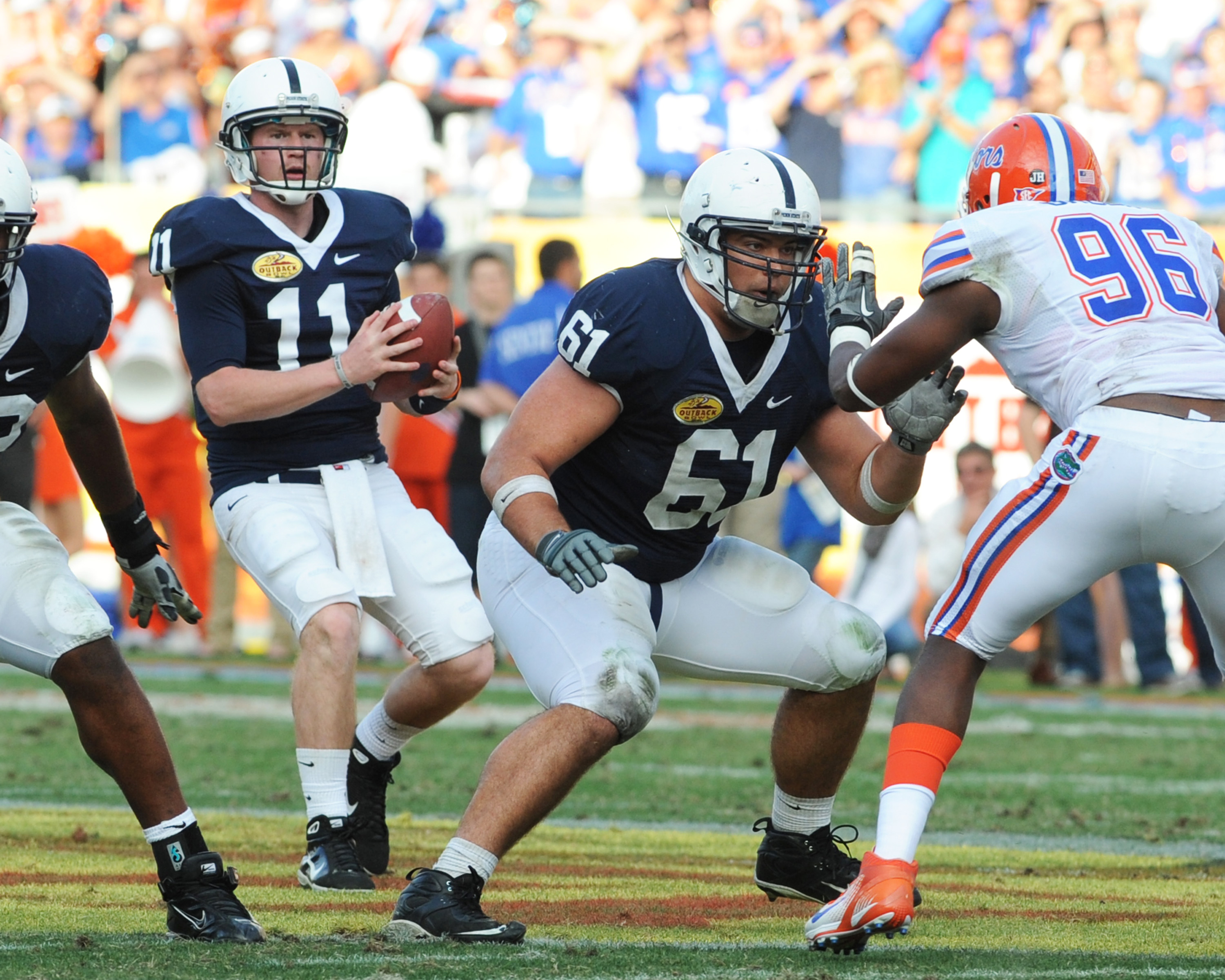 TAMPA, FL - JANUARY 1:  Guard Stefan Wisniewski #61 of the Penn State Nittany Lions blocks against the Florida Gators January 1, 2010 in the 25th Outback Bowl at Raymond James Stadium in Tampa, Florida.  (Photo by Al Messerschmidt/Getty Images)