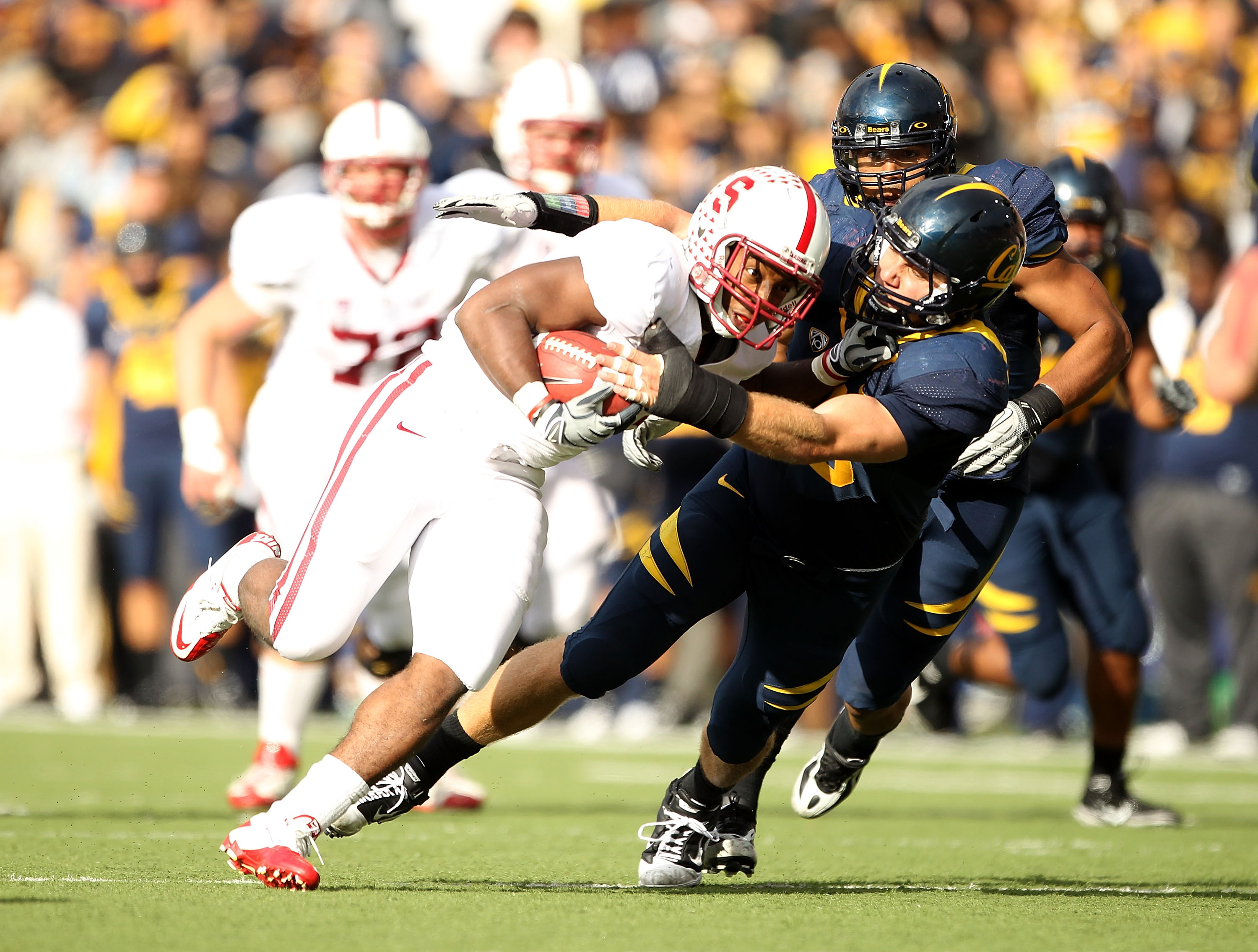 BERKELEY, CA - NOVEMBER 20:  Stepfan Taylor #33 of the Stanford Cardinal is tackled by Mike Mohamed #18 of the California Golden Bears at California Memorial Stadium on November 20, 2010 in Berkeley, California.  (Photo by Ezra Shaw/Getty Images)