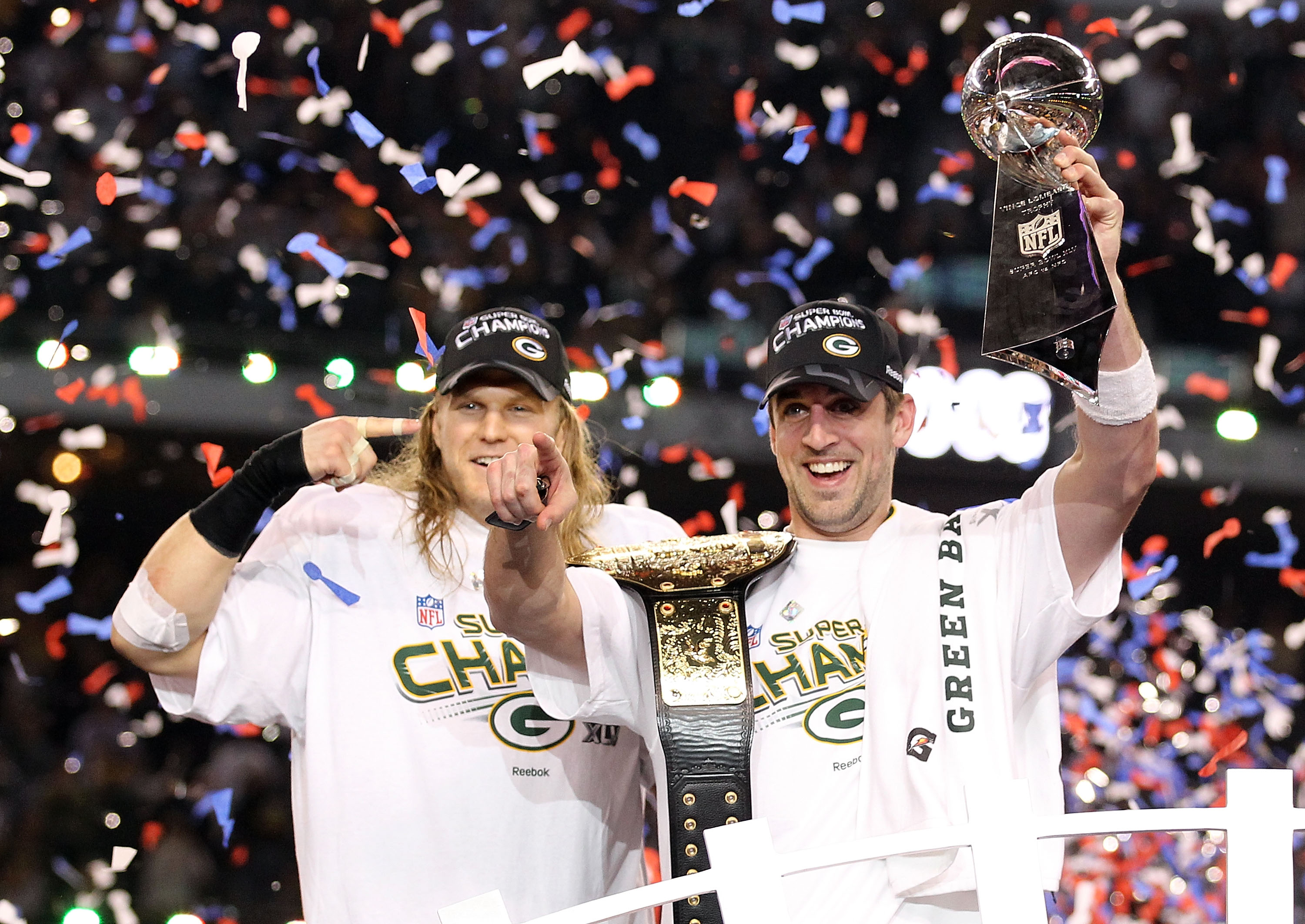ARLINGTON, TX - FEBRUARY 06:  Super Bowl MVP Aaron Rodgers #12 of the Green Bay Packers holds up the Vince Lombardi Trophy as Clay Matthews #52 looks on after winning Super Bowl XLV 31-25 against the Pittsburgh Steelers at Cowboys Stadium on February 6, 2