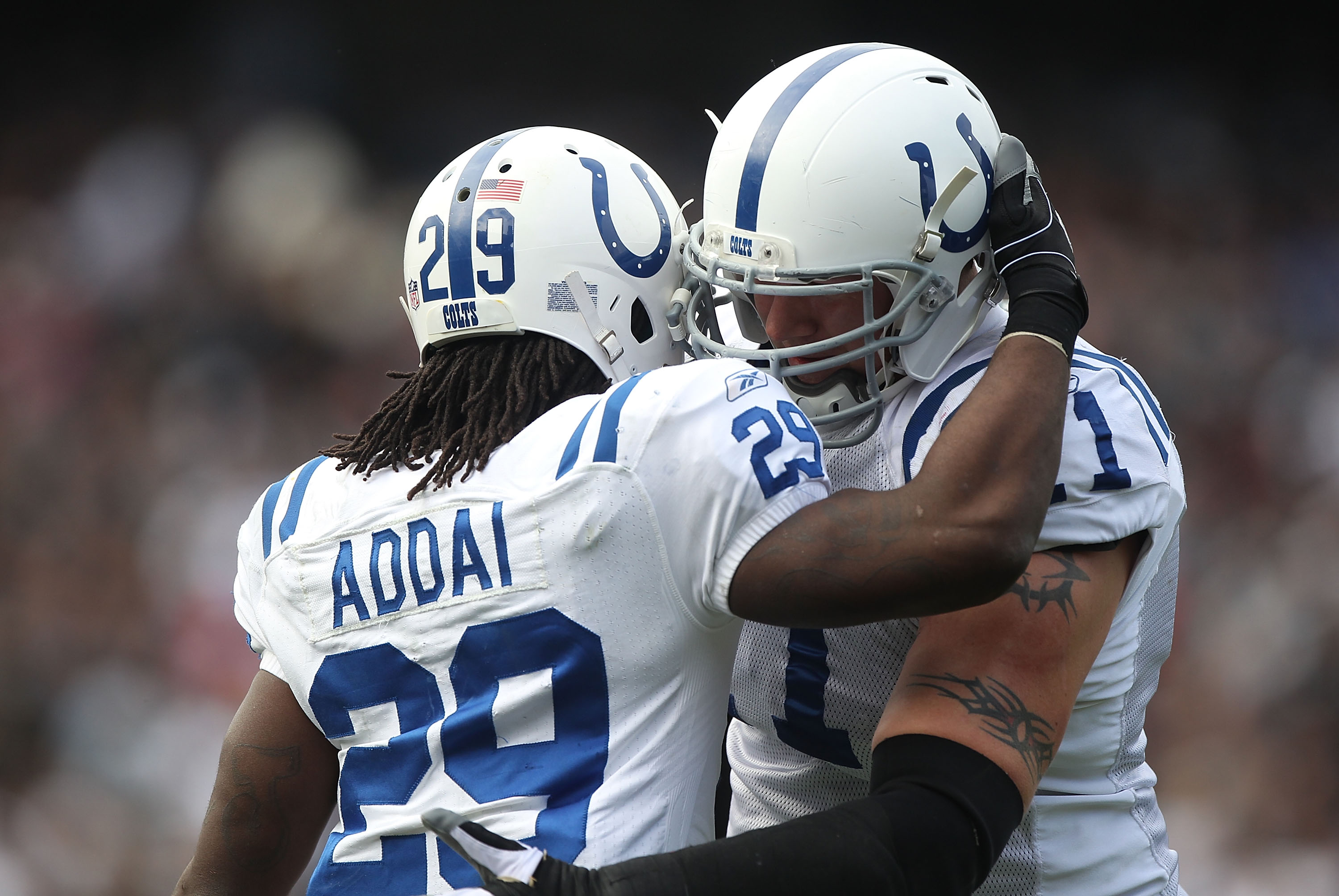 OAKLAND, CA - DECEMBER 26:  Joseph Addai #29 of the Indianapolis Colts celebrates with Jamey Richard #61 after scoring a touchdown against the Oakland Raiders during an NFL game at Oakland-Alameda County Coliseum on December  26, 2010 in Oakland, Californ