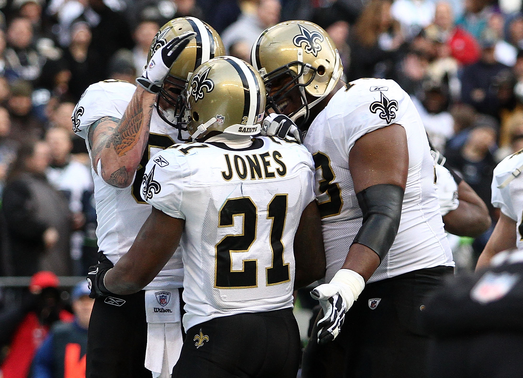 SEATTLE, WA - JANUARY 08:  Julius Jones #21 of the New Orleans Saints celebrates his five-yard touchdown run in the second quarter with teammates against the Seattle Seahawks during the 2011 NFC wild-card playoff game at Qwest Field on January 8, 2011 in