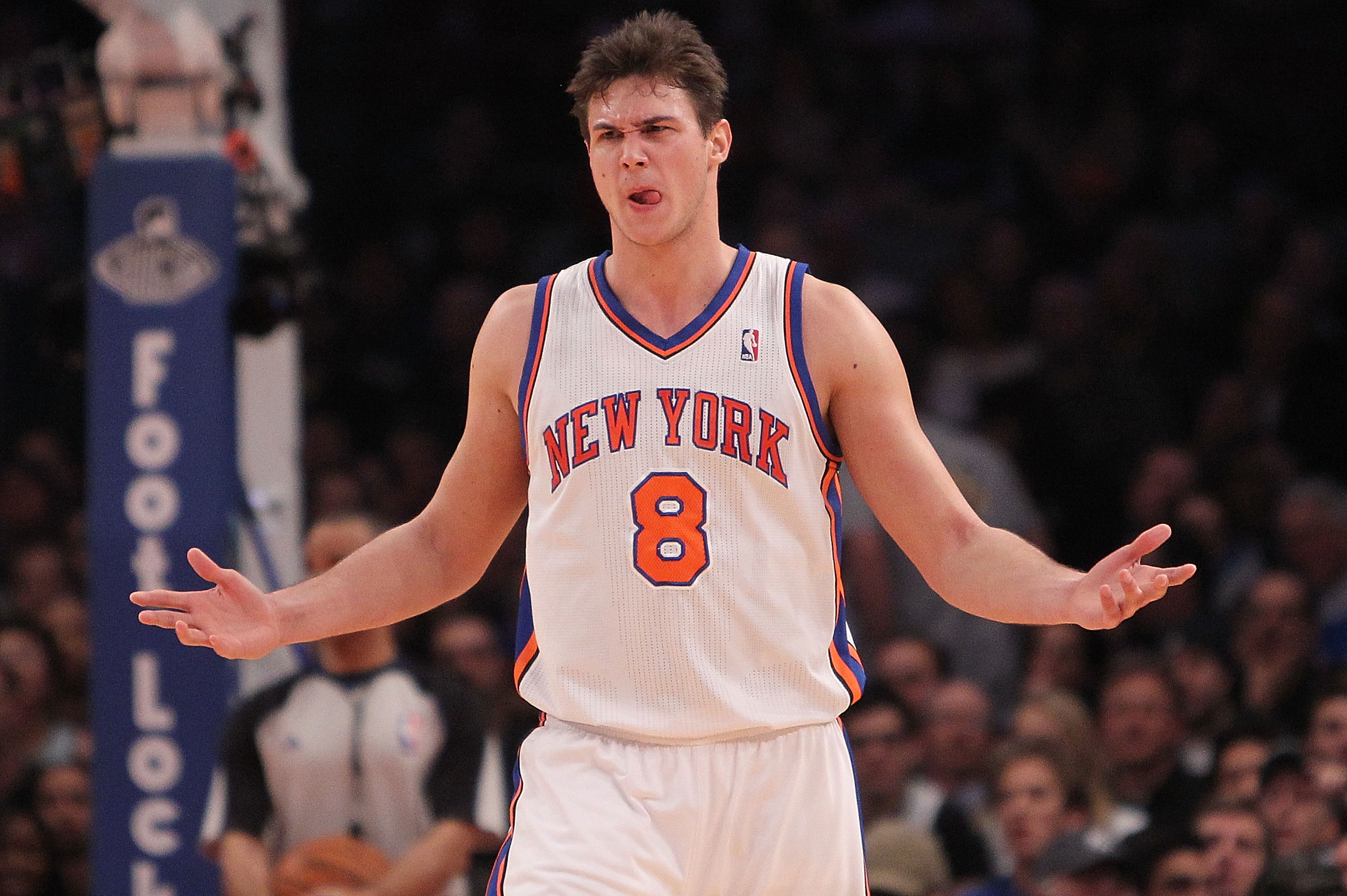 NEW YORK, NY - FEBRUARY 02:  Danilo Gallinari #8 of the New York Knicks questions a call against the Dallas Mavericks at Madison Square Garden on February 2, 2011 in New York City. NOTE TO USER: User expressly acknowledges and agrees that, by downloading