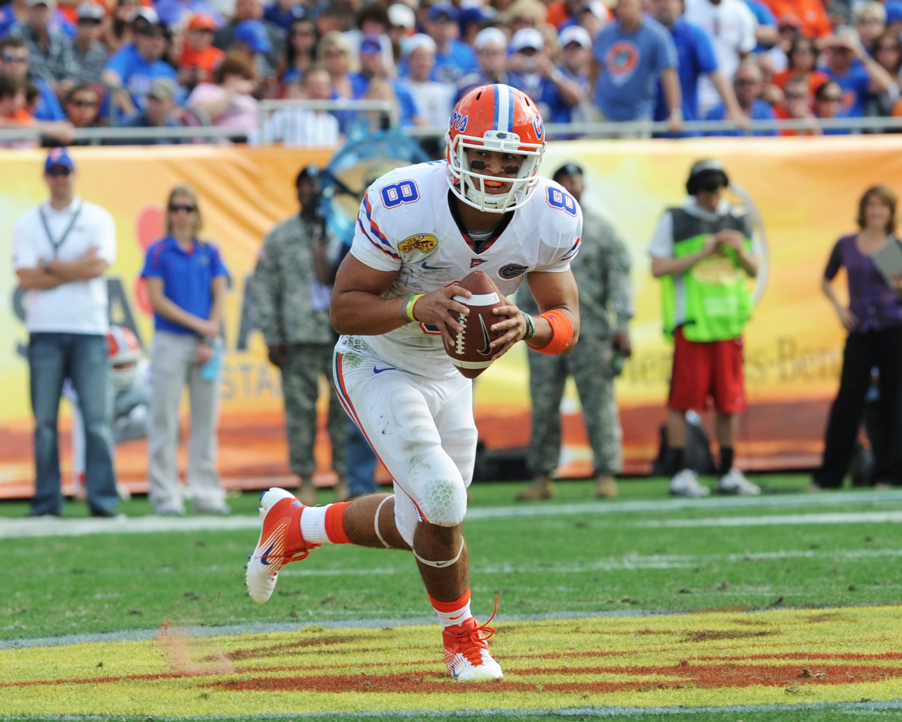 TAMPA, FL - JANUARY 1:  Quarterback Trey Burton #8  of the Florida Gators rushes upfield against the Penn State Nittany Lions January 1, 2010 in the 25th Outback Bowl at Raymond James Stadium in Tampa, Florida.  (Photo by Al Messerschmidt/Getty Images)