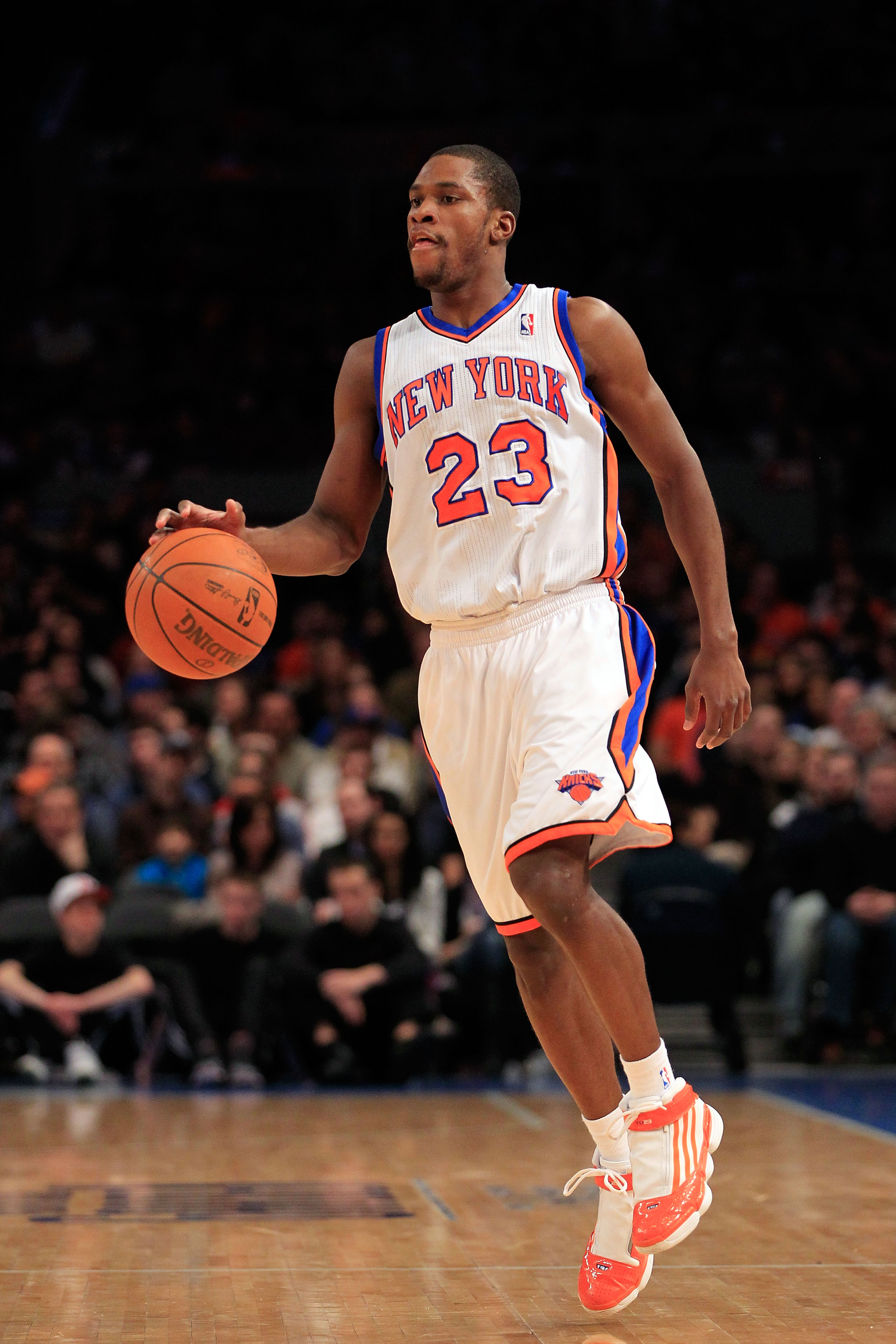 NEW YORK, NY - FEBRUARY 06:  Toney Douglas #23 of the New York Knicks dribbles the ball against the Philadelphia 76ers at Madison Square Garden on February 6, 2011 in New York City. NOTE TO USER: User expressly acknowledges and agrees that, by downloading