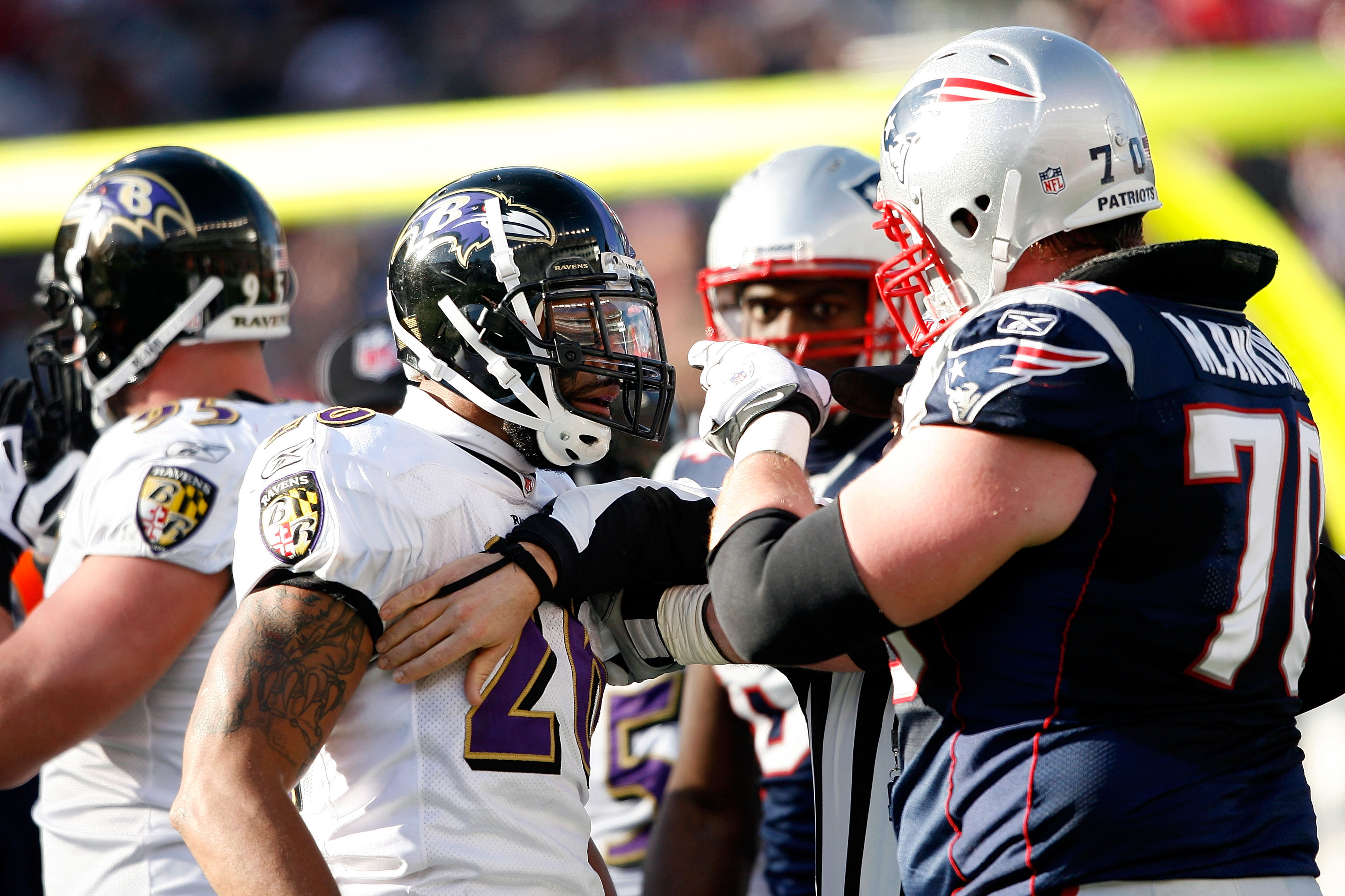 FOXBORO, MA - JANUARY 10:  Logan Mankins #70 of the New England Patriots and Ed Reed #20 of  the Baltimore Ravens get in each others face during the 2010 AFC wild-card playoff game at Gillette Stadium on January 10, 2010 in Foxboro, Massachusetts.  (Photo