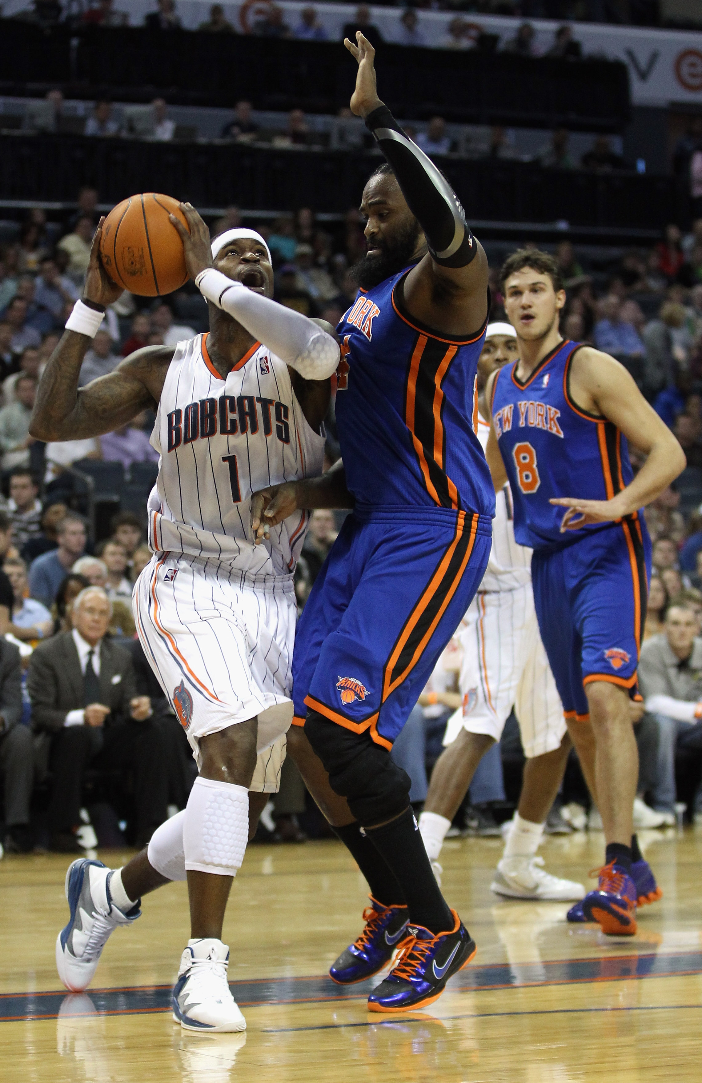 CHARLOTTE, NC - NOVEMBER 24:  Ronny Turiaf #14 of the New York Knicks tries to stop Stephen Jackson #1 of the Charlotte Bobcats during their game at Time Warner Cable Arena on November 24, 2010 in Charlotte, North Carolina.  NOTE TO USER: User expressly a