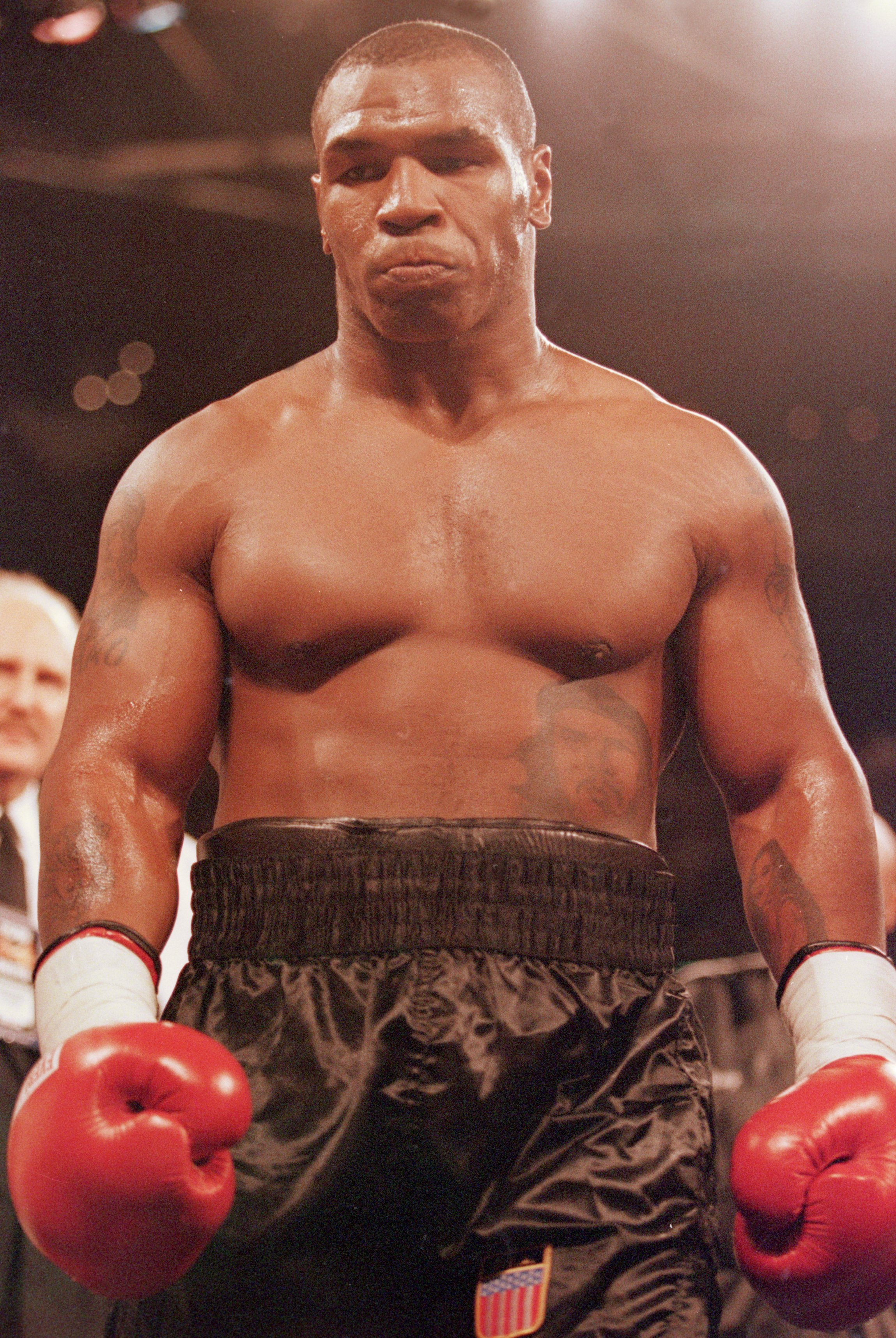 20 Oct 2000:  Mike Tyson walks to a corner during the fight against Andrew Golota at the Palace of Auburn Hills in Auburn, Michigan. Tyson defeated Golota in the third round by technical knockout.Mandatory Credit: Al Bello  /Allsport