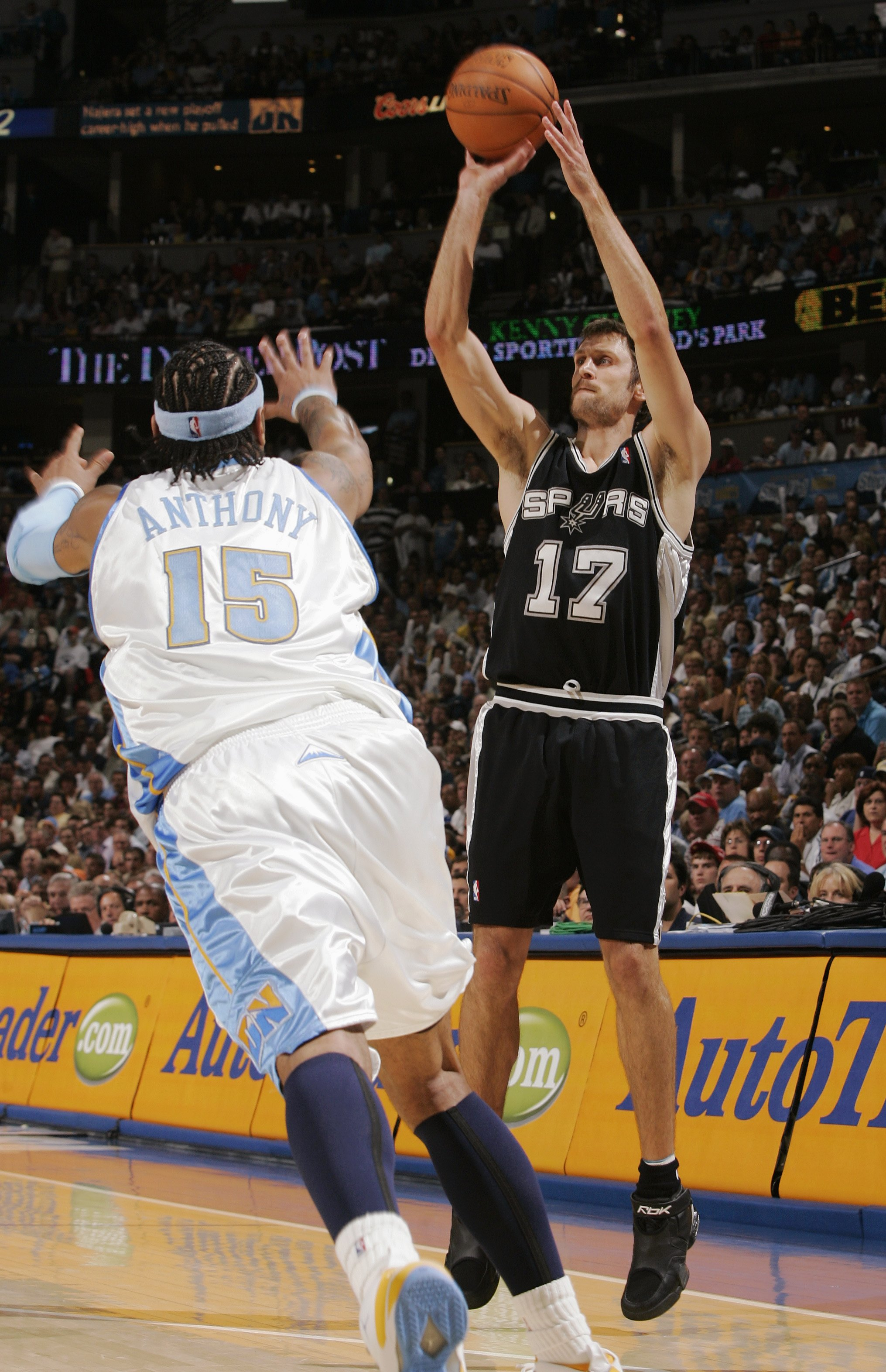 DENVER - APRIL 30:   Brent Barry #17 of the San Antonio Spurs shoots over Carmelo Anthony  #15 of the Denver Nuggets in Game Four of the Western Conference Quarterfinals during the 2007 NBA Playoffs at the Pepsi Center on April 30, 2007 in Denver, Colorad