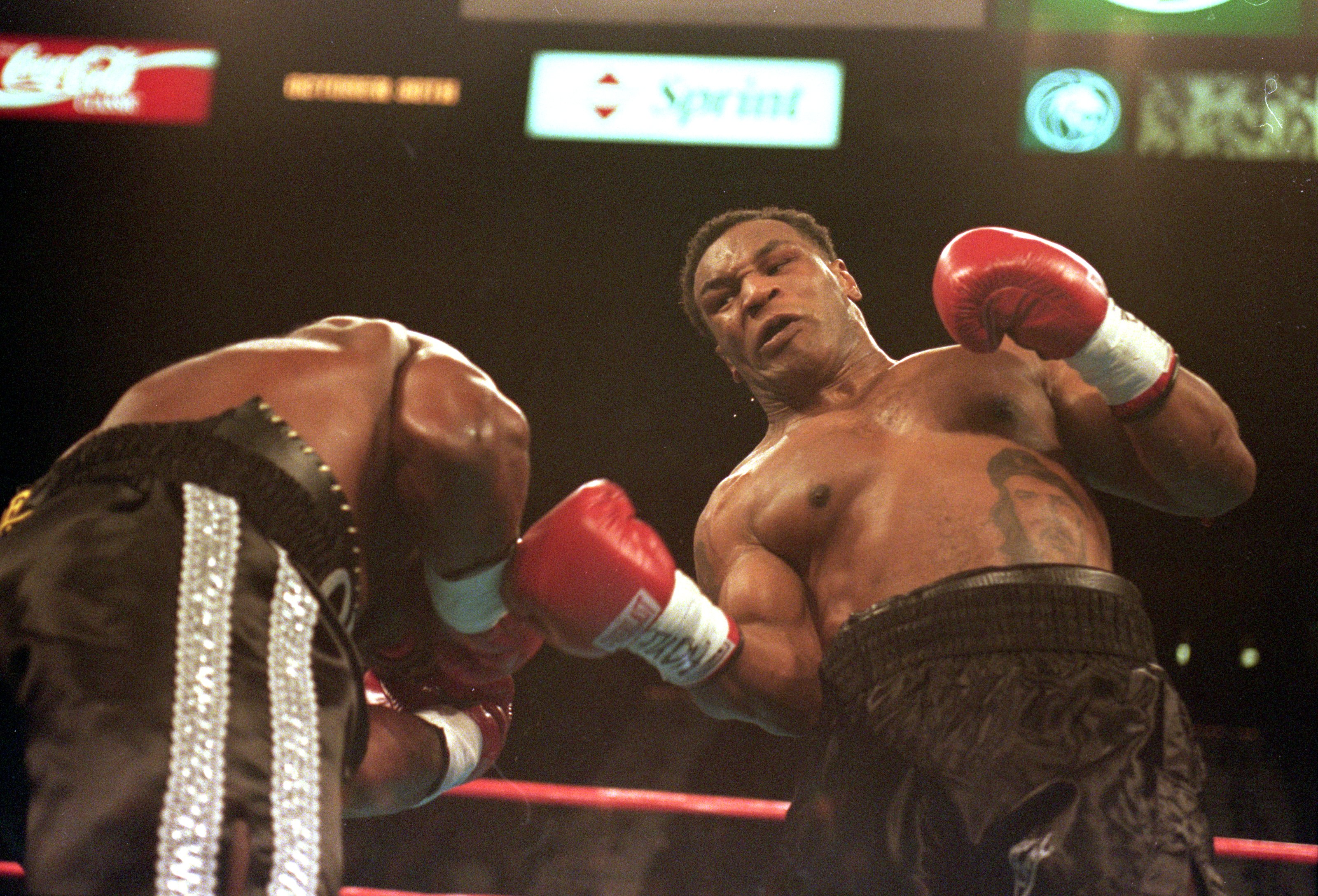 23 Oct 1999: Mike Tyson lands right upper -cut during the fight against Orlin Norris at the MGM Grand Hotel in Las Vegas, Nevada. The fight ended in a no contest.