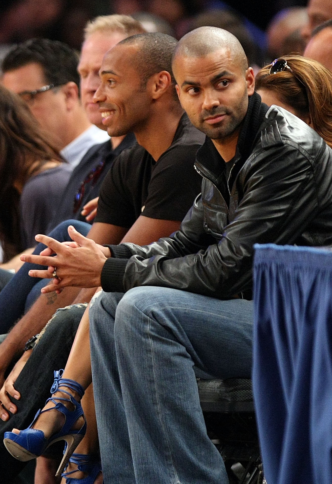 NEW YORK - AUGUST 15:  Thierry Henry and Tony Parker watch on during the United States and France exhibition game as part of the World Basketball Festival at Madison Square Garden on August 15, 2010 in New York City.  (Photo by Nick Laham/Getty Images)