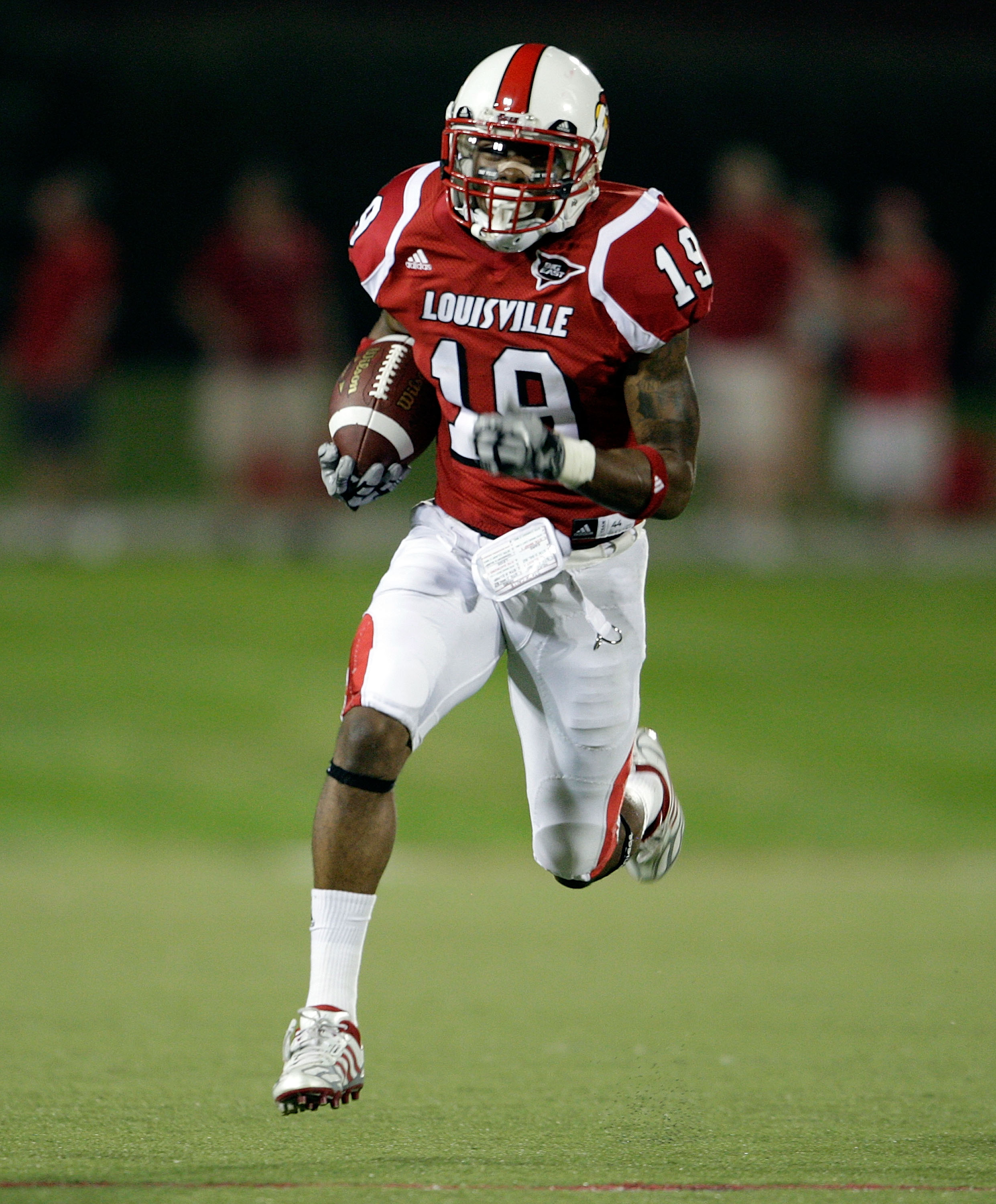 LOUISVILLE, KY - SEPTEMBER 05:  Johnny Patrick #19 of the Louisville Cardinals runs with the balll after intercepting a pass during the game against the Indiana State Sycamores at Papa John's Cardinal Stadium on September 5, 2009 in Louisville, Kentucky.