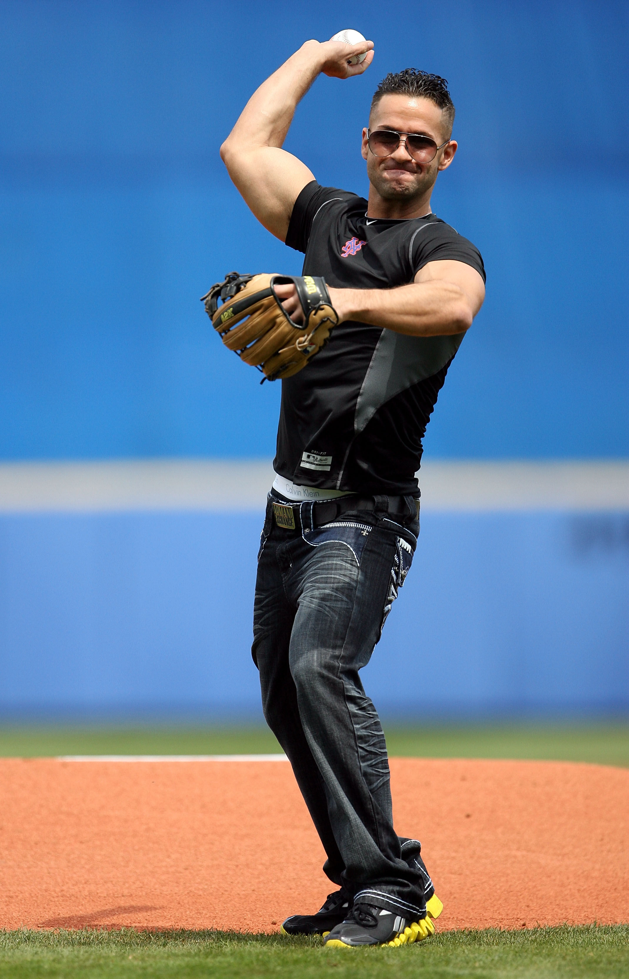 PORT ST. LUCIE, FL - MARCH 24:  Mike 'The Situation' Sorrentino of the reality show Jersey Shore, throws out the first pitch before the New York Mets take on the Houston Astros at Tradition Field on March 24, 2010 in Port St. Lucie, Florida.  (Photo by Do