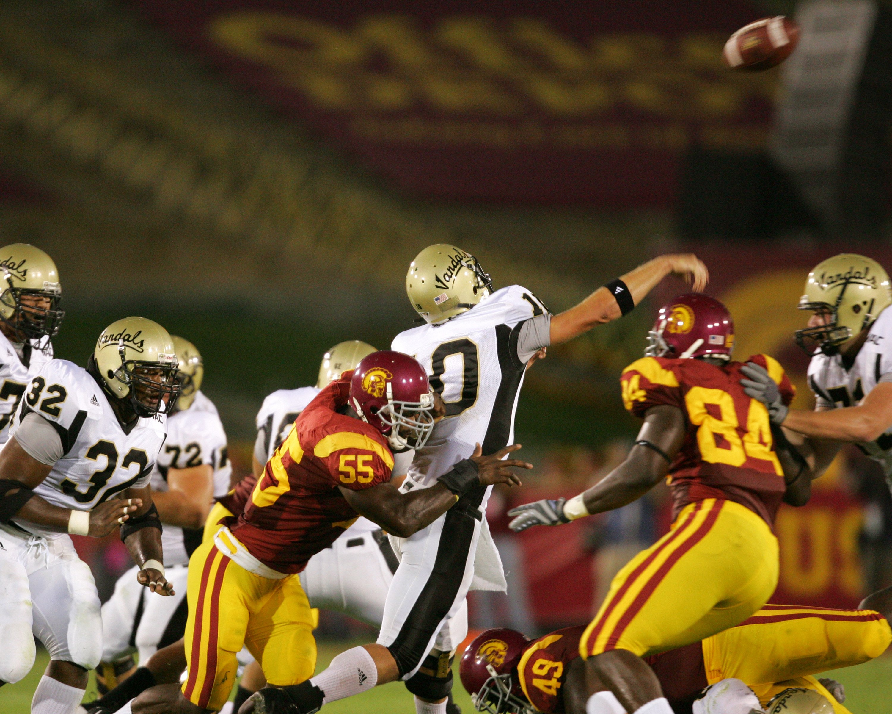 LOS ANGELES - SEPTEMBER 1:  USC linebacker Keith Rivers #55 unloads on Idaho quarterback Nate Enderle #10 in the top-ranked Trojans 38-10 win over the Vandals at the Los Angeles Memorial Coliseum on September 1, 2007 in Los Angeles, California. The top-ra
