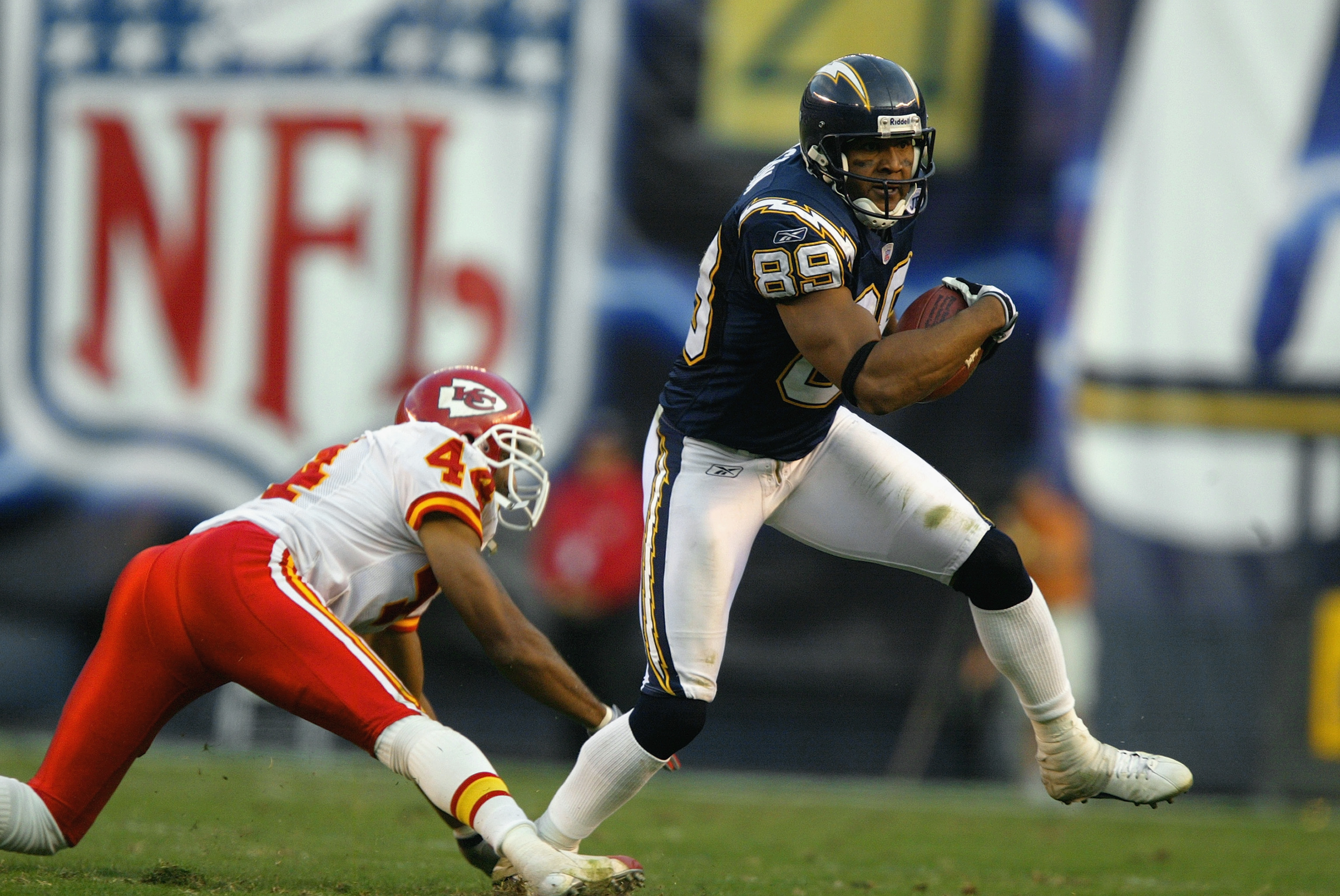 SAN DIEGO - NOVEMBER 30:  Wide receiver David Boston #89 of the San Diego Chargers carries the ball around cornerback Eric Warfield #42 of the Kansas City Chiefs during the game at Qualcomm Stadium on November 30, 2003 in San Diego, California. The Chiefs