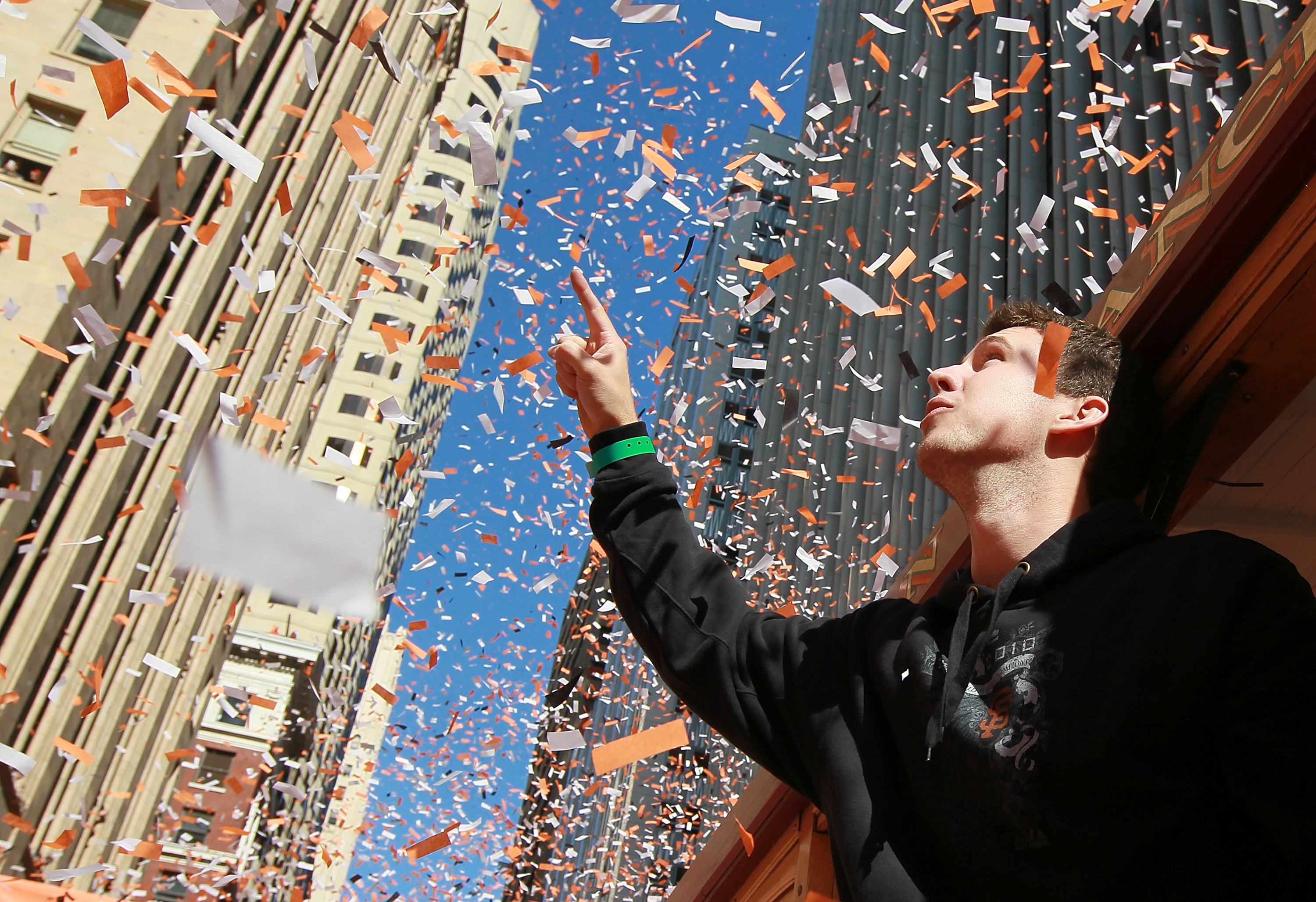 SAN FRANCISCO - NOVEMBER 03:  Buster Posey of the San Francisco Giants celebrates during the Giants' vicotry parade on November 3, 2010 in San Francisco, California. Thousands of Giants fans lined the streets of San Francisco to watch the San Francisco Gi