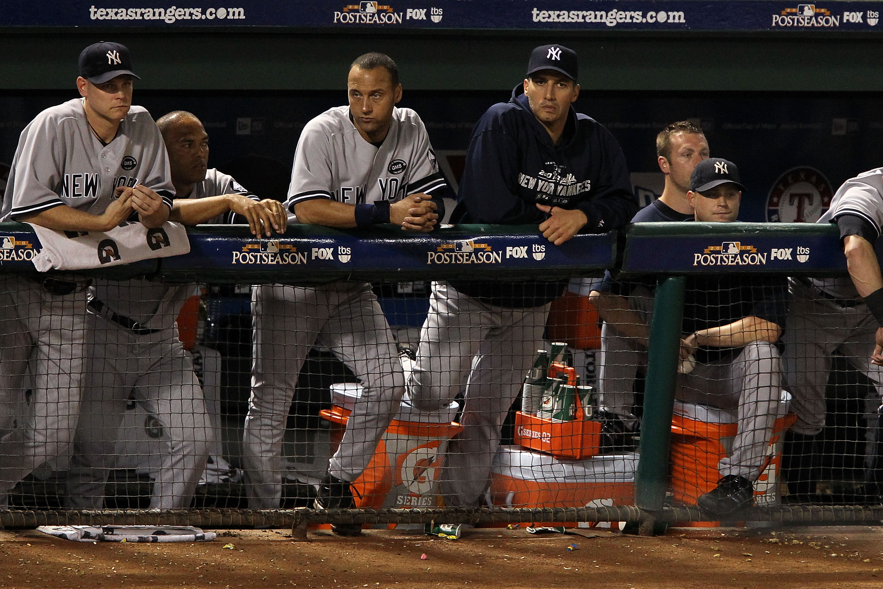 ARLINGTON, TX - OCTOBER 22:  (L-R) Kerry Wood #39, Mariano Rivera #42, Derek Jeter #2, and Andy Pettitte #46 of the New York Yankees look on from the dugout during Game Six of the ALCS against the Texas Rangers during the 2010 MLB Playoffs at Rangers Ball