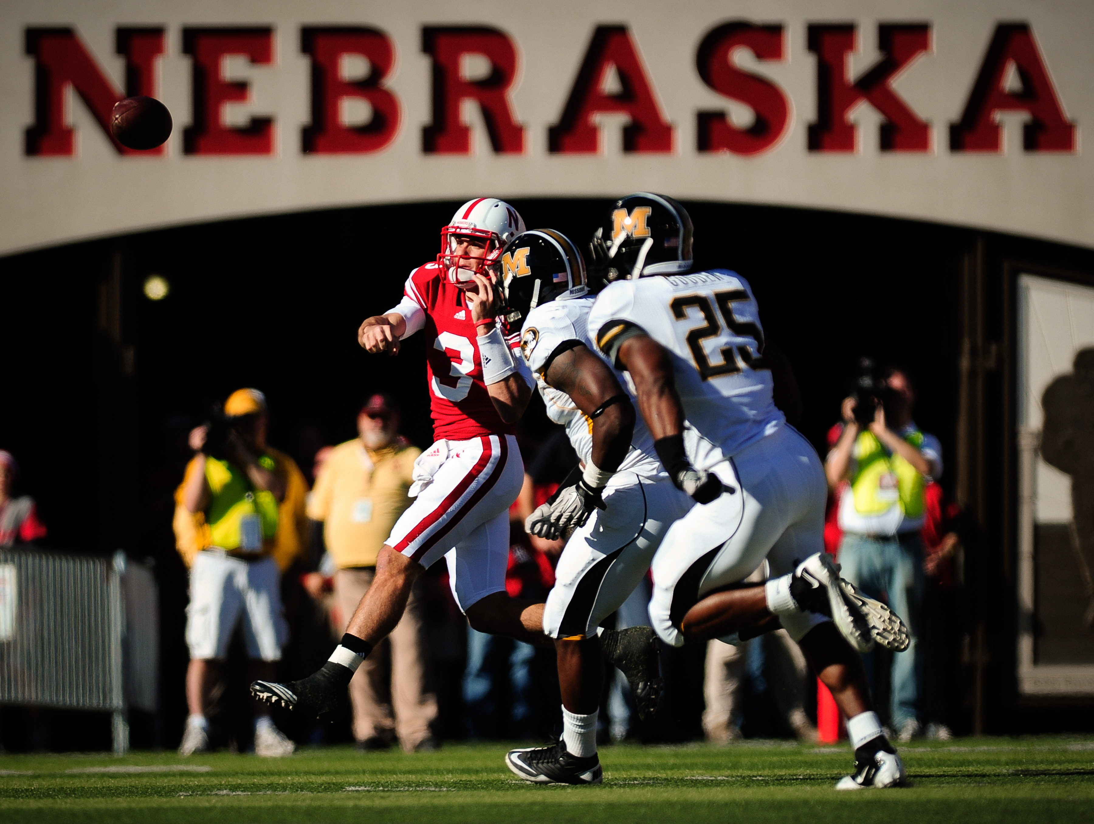 LINCOLN, NE - OCTOBER 30: Quarterback Taylor Martinez #3 of the Nebraska Cornhuskers throws over the Missouri Tigers defense during first half action of their game at Memorial Stadium on October 30, 2010 in Lincoln, Nebraska. Nebraska Defeated Missouri 31