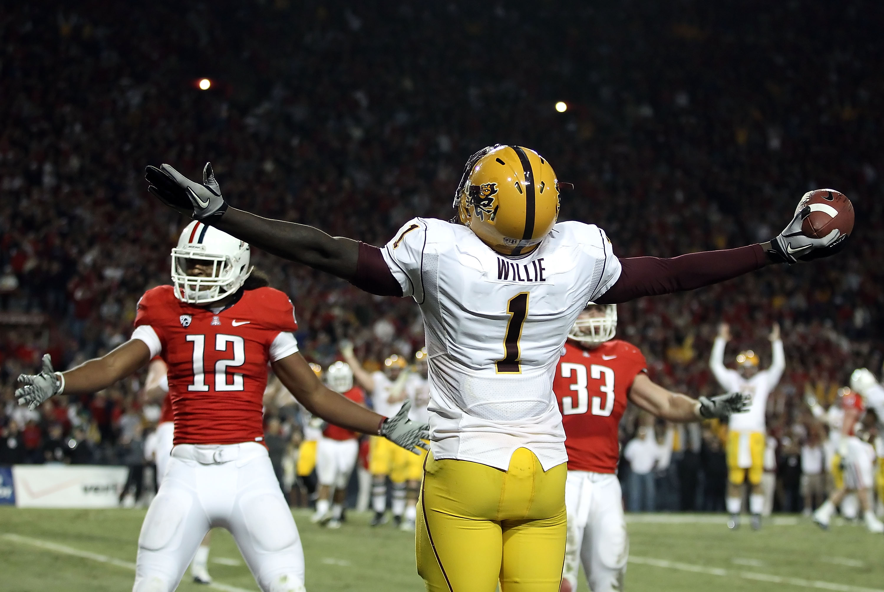 TUCSON, AZ - DECEMBER 02:  Wide receiver Mike Willie #1 of the Arizona State Sun Devils celebrates after scoring a touchdown reception during the college football game at Arizona Stadium on December 2, 2010 in Tucson, Arizona. The Sun Devils defeated the