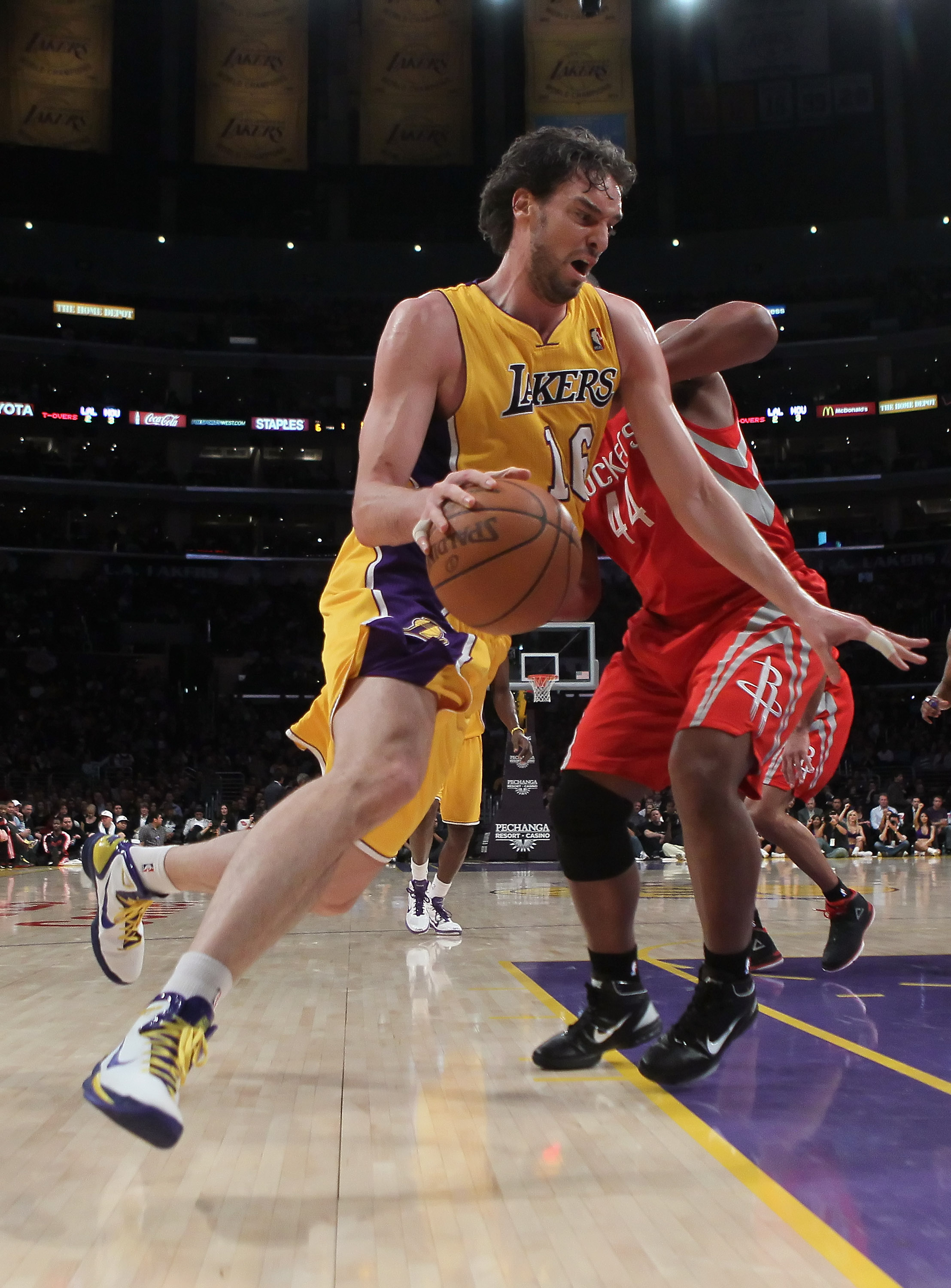 LOS ANGELES, CA - FEBRUARY 01:  Pau Gasol #16 of the Los Angeles Lakers drives around Chuck Hayes #44 of the Houston Rockets in the first half at Staples Center on February 1, 2011 in Los Angeles, California. The Lakers defeated the Rockets 114-106. NOTE