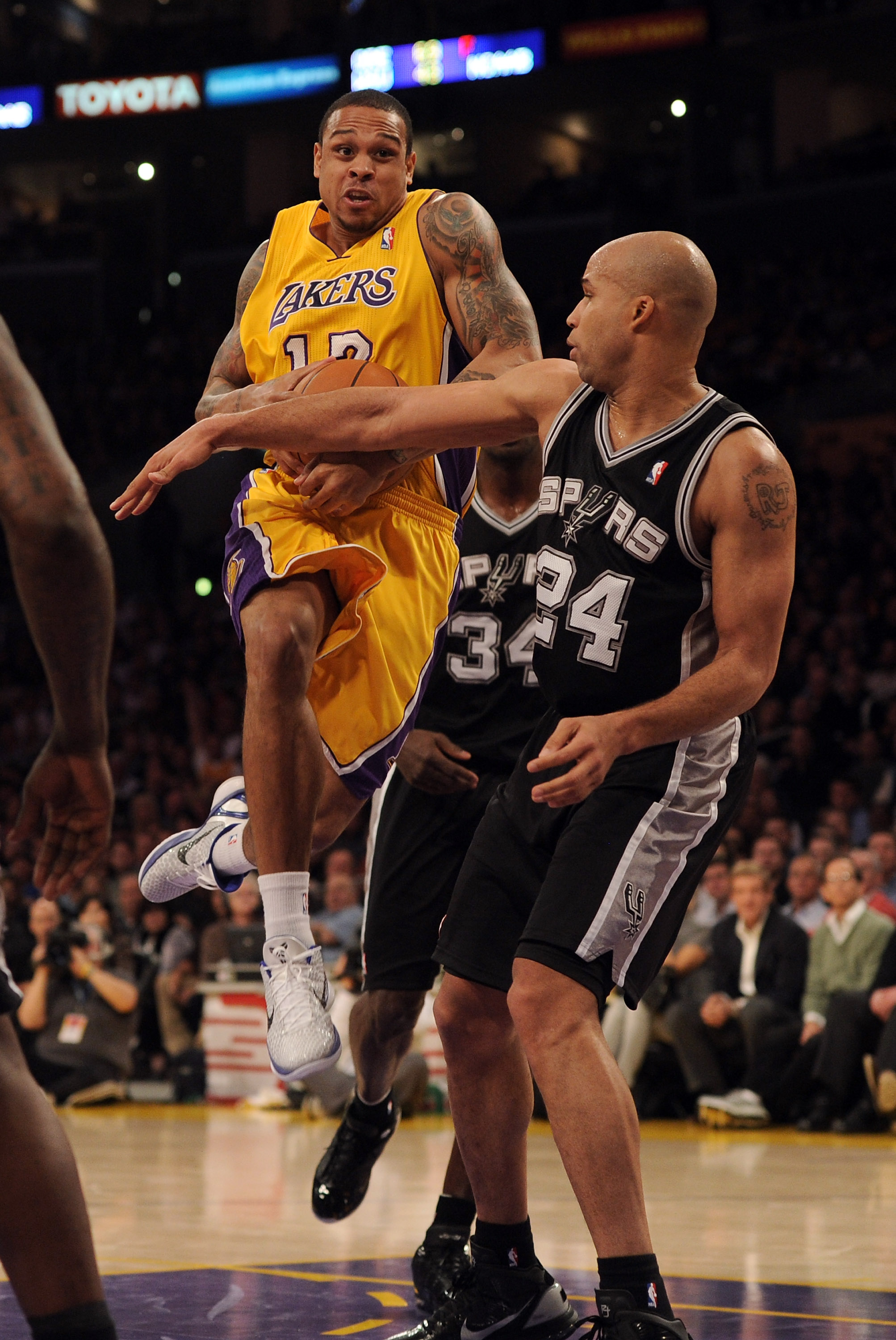 LOS ANGELES, CA - FEBRUARY 03:  Shannon Brown #12 of the Los Angeles Lakers tries to get a shot off in front of Richard Jeffferson #24 of the San Antonio Spurs at Staples Center on February 3, 2011 in Los Angeles, California.  NOTE TO USER: User expressly