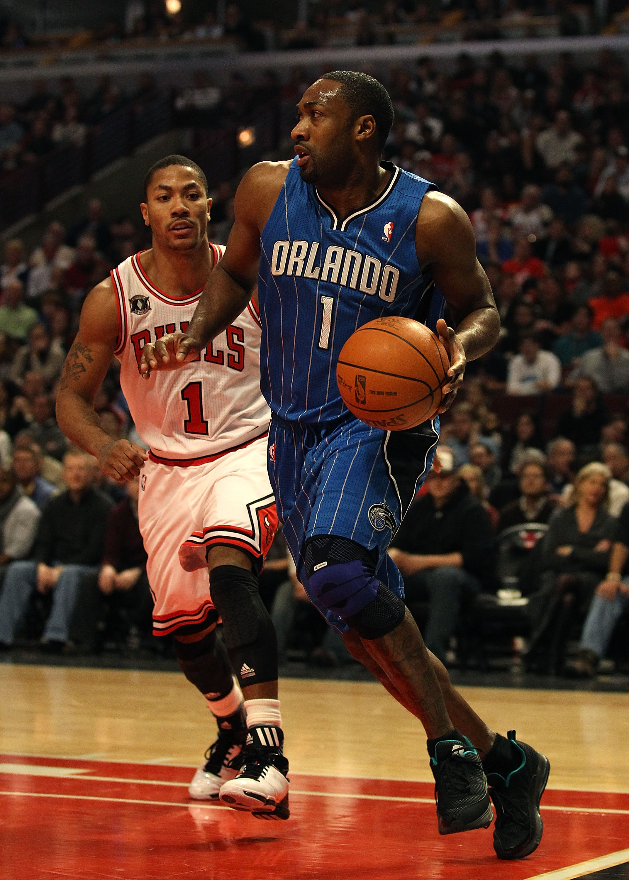 CHICAGO, IL - JANUARY 28: Gilbert Arenas #1 of the Orlando Magic moves past Derrick Rose #1 of the Chicago Bulls at the United Center on January 28, 2011 in Chicago, Illinois. The Bulls defeated the Magic 99-90. NOTE TO USER: User expressly acknowledges a