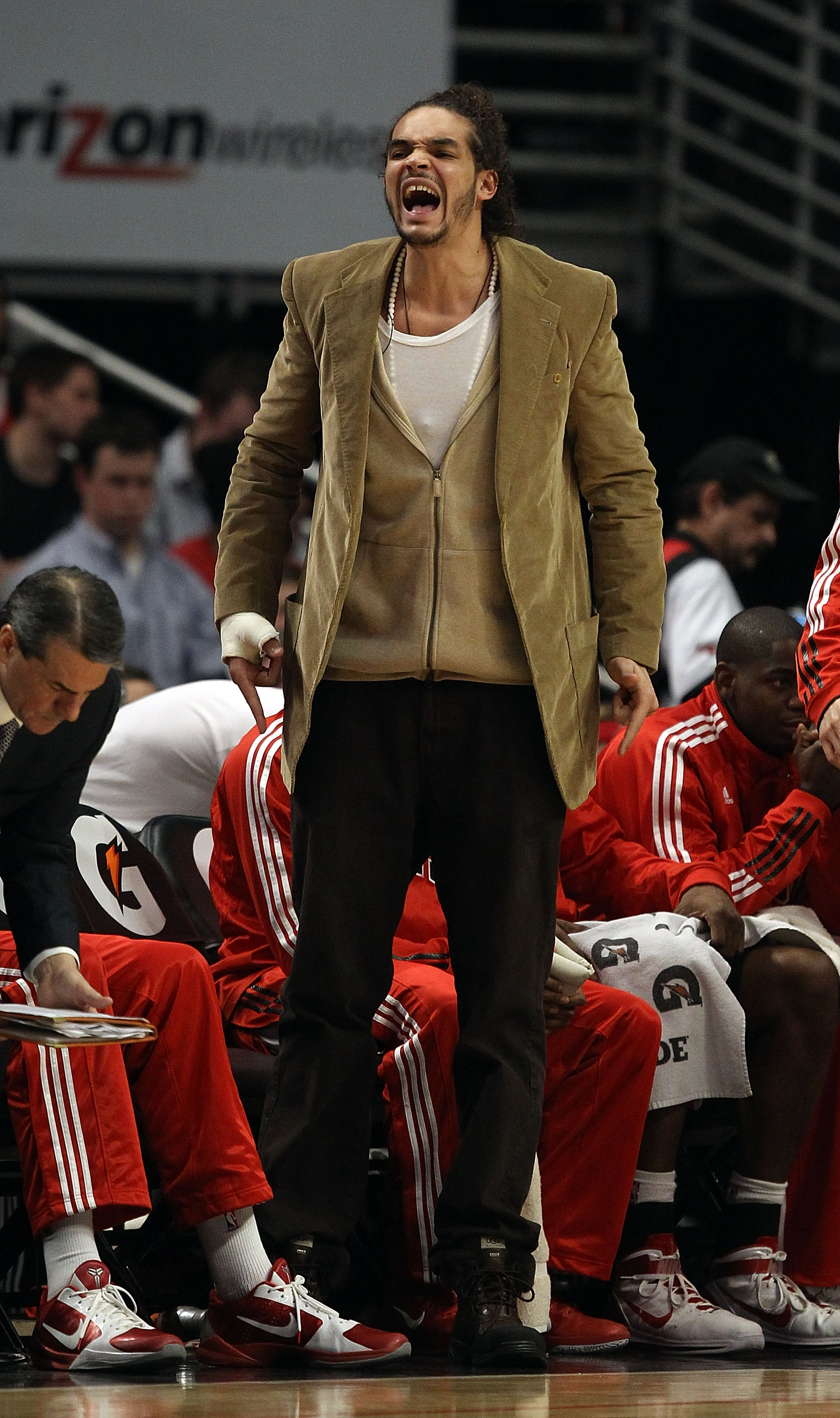 CHICAGO, IL - JANUARY 28: Injured player Joakim Noah of the Chicago Bulls shouts encouragement to teammates from the bench during a game against the Orlando Magic at the United Center on January 28, 2011 in Chicago, Illinois. The Bulls defeated the Magic