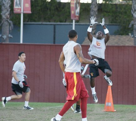 Dion Bailey goes high to intercept
