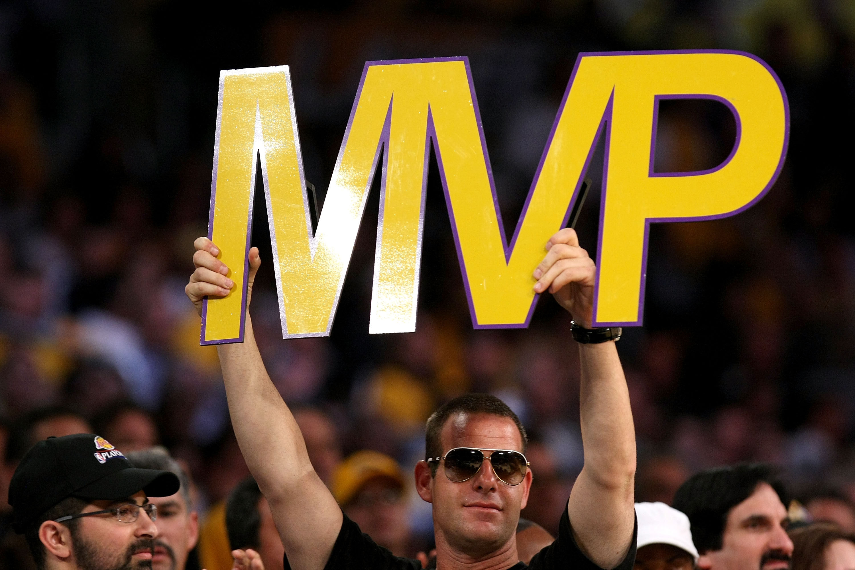 LOS ANGELES, CA - MAY 07:  A fan holds up an MVP sign as Kobe Bryant #24 of the Los Angeles Lakers is awarded the MVP trophy during the Lakers' win over the Utah Jazz in Game Two of the Western Conference Semifinals during the 2008 NBA Playoffs on May 7,