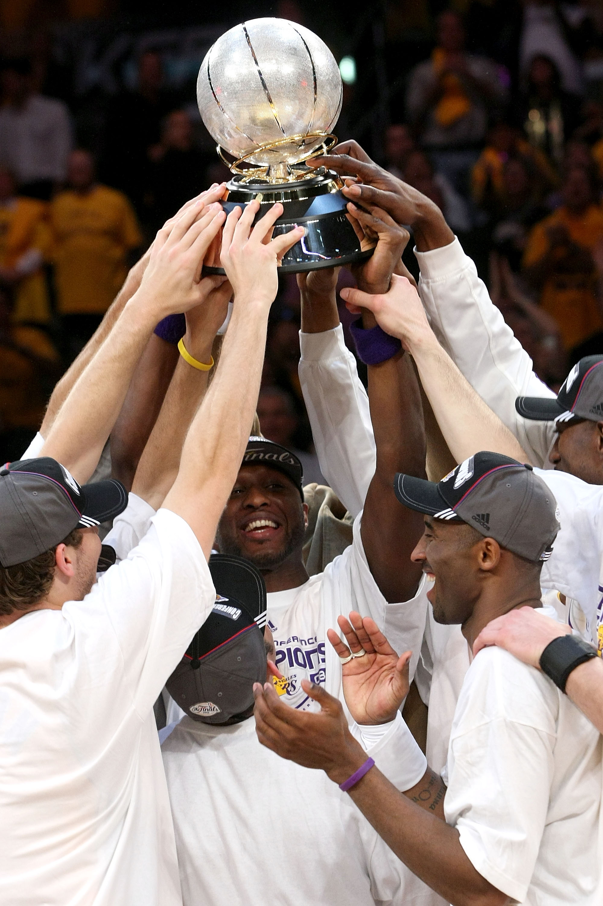 LOS ANGELES, CA - MAY 29:  The Los Angeles Lakers hold up at the Western Conference Championship trophy after they defeated the San Antonio Spurs in Game Five of the Western Conference Finals during the 2008 NBA Playoffs on May 29, 2008 at Staples Center